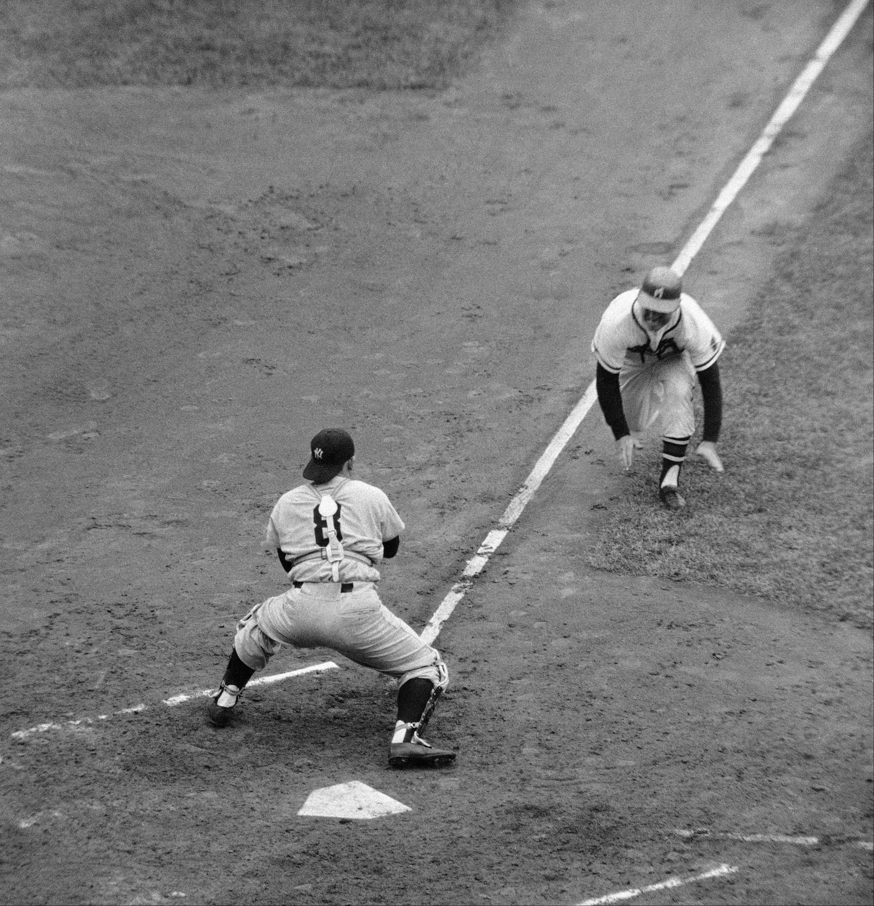 With New York Yankee Yogi Berra blocking the plate, Milwaukee Brave Andy Pafko is thrown out while trying to score from third on a fly out during the 1958 World Series. Pafko's Braves won the 1957 World Series, but lost this rematch with the Yankees.