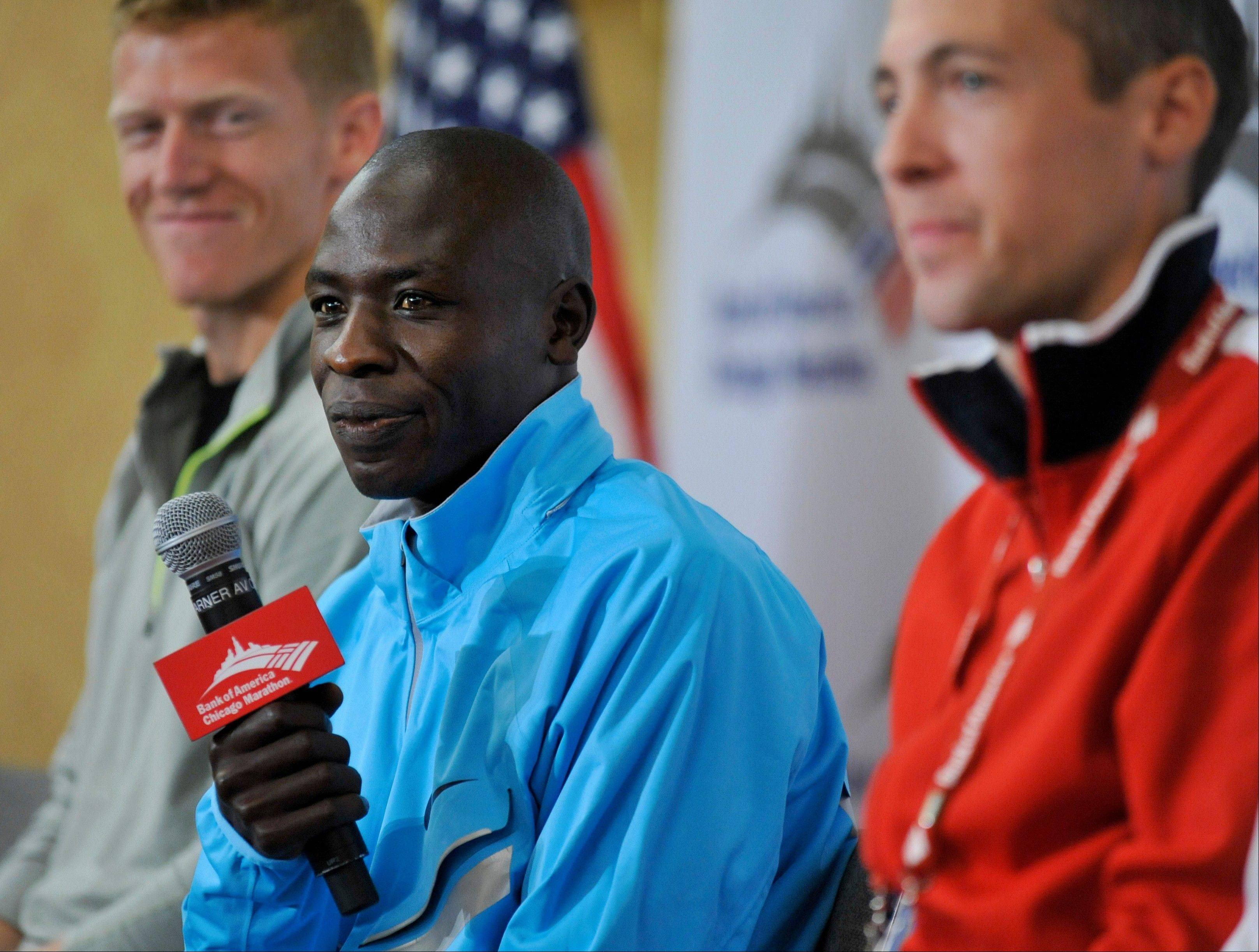 The 2011 Chicago Marathon winner, Kenya's Moses Mosop, center, didn't race in last year's event, but he has his sights set on the course record for Sunday's race.