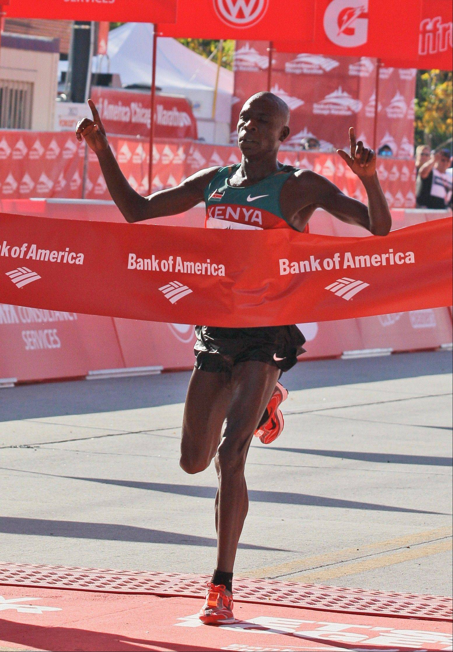 Moses Mosop of Kenya celebrates as he wins the Chicago Marathon in 2011 in record time (2:05:37). Last year, Ethiopia's Tsegaye Kebede set a new record (2:04:38).