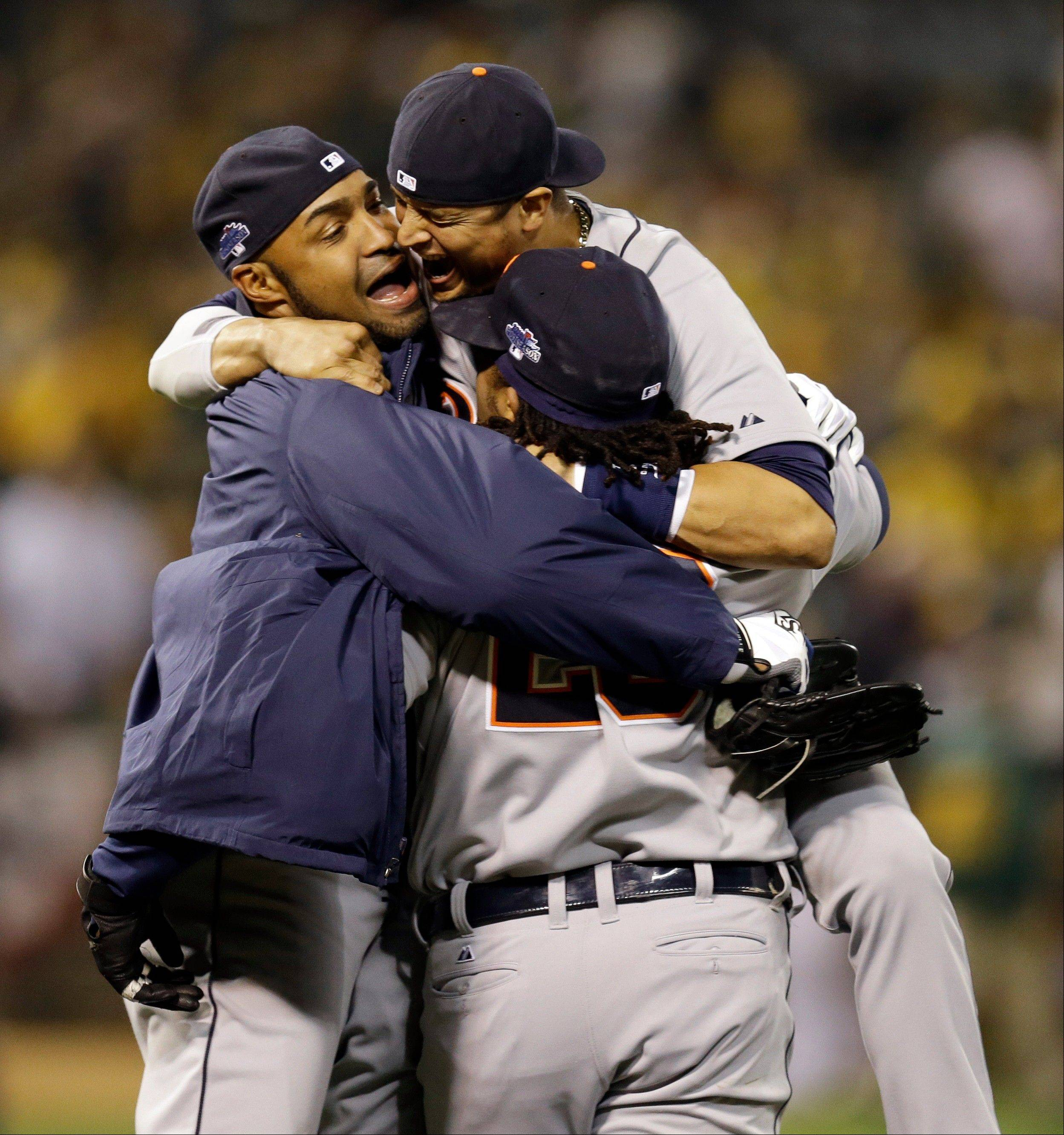 The Detroit Tigers celebrate after beating the Oakland Athletics 3-0 Thursday to win Game 5 of an American League Division Series in Oakland, Calif.