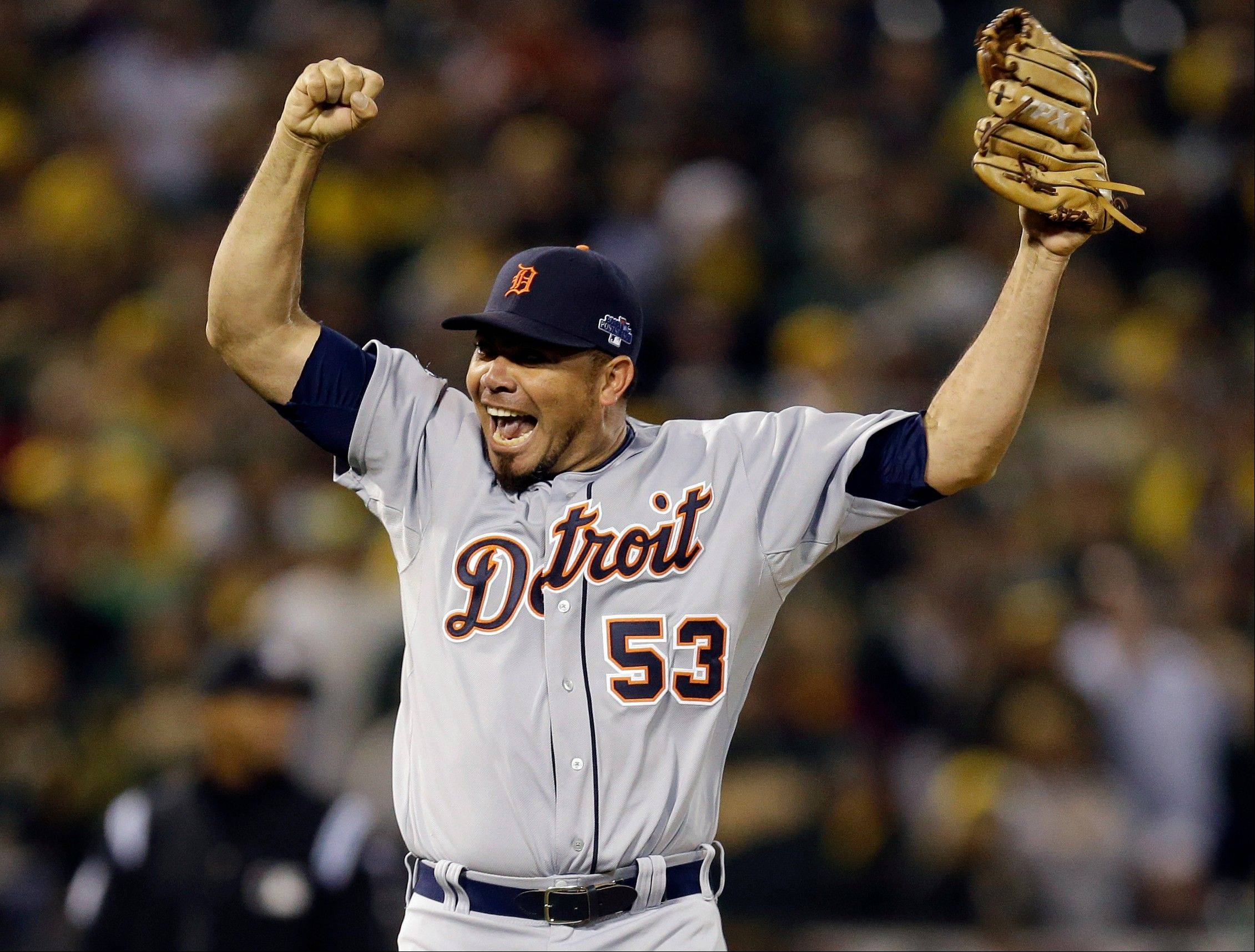 Tigers pitcher Joaquin Benoit (53) celebrates after the final out of Game 5.