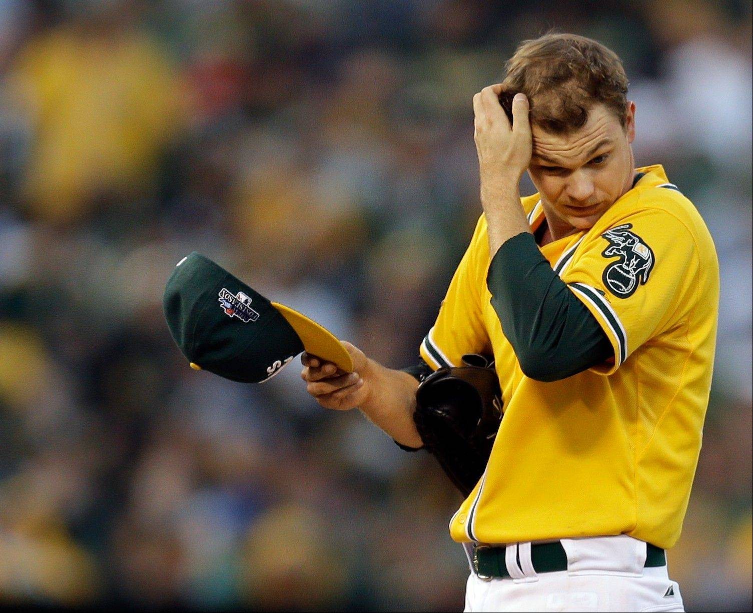 Athletics starting pitcher Sonny Gray adjusts his cap after loading the bases in the fourth inning of Game 5 Thursday in Oakland.
