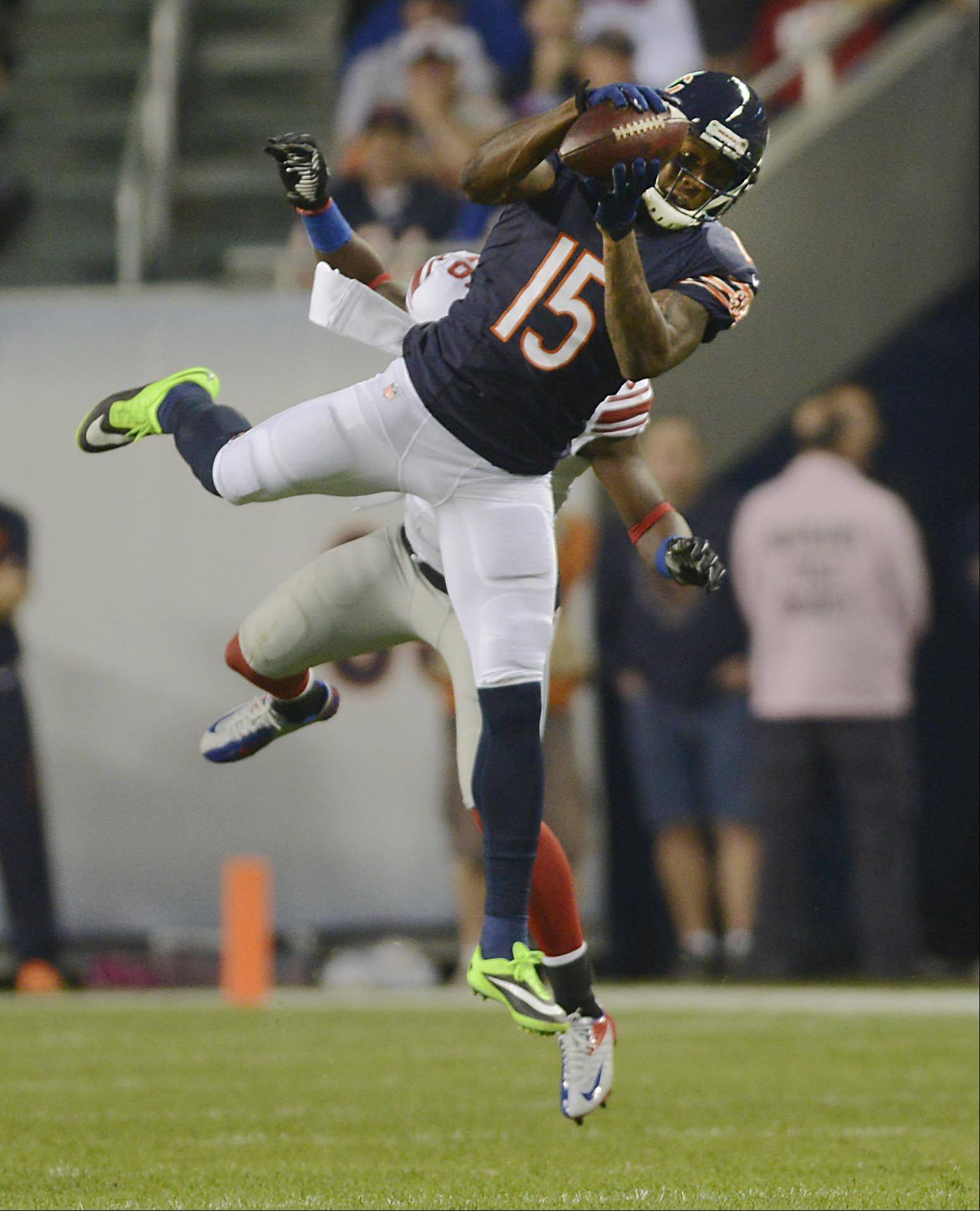 Chicago Bears wide receiver Brandon Marshall makes a catch against New York Giants safety Antrel Rolle.
