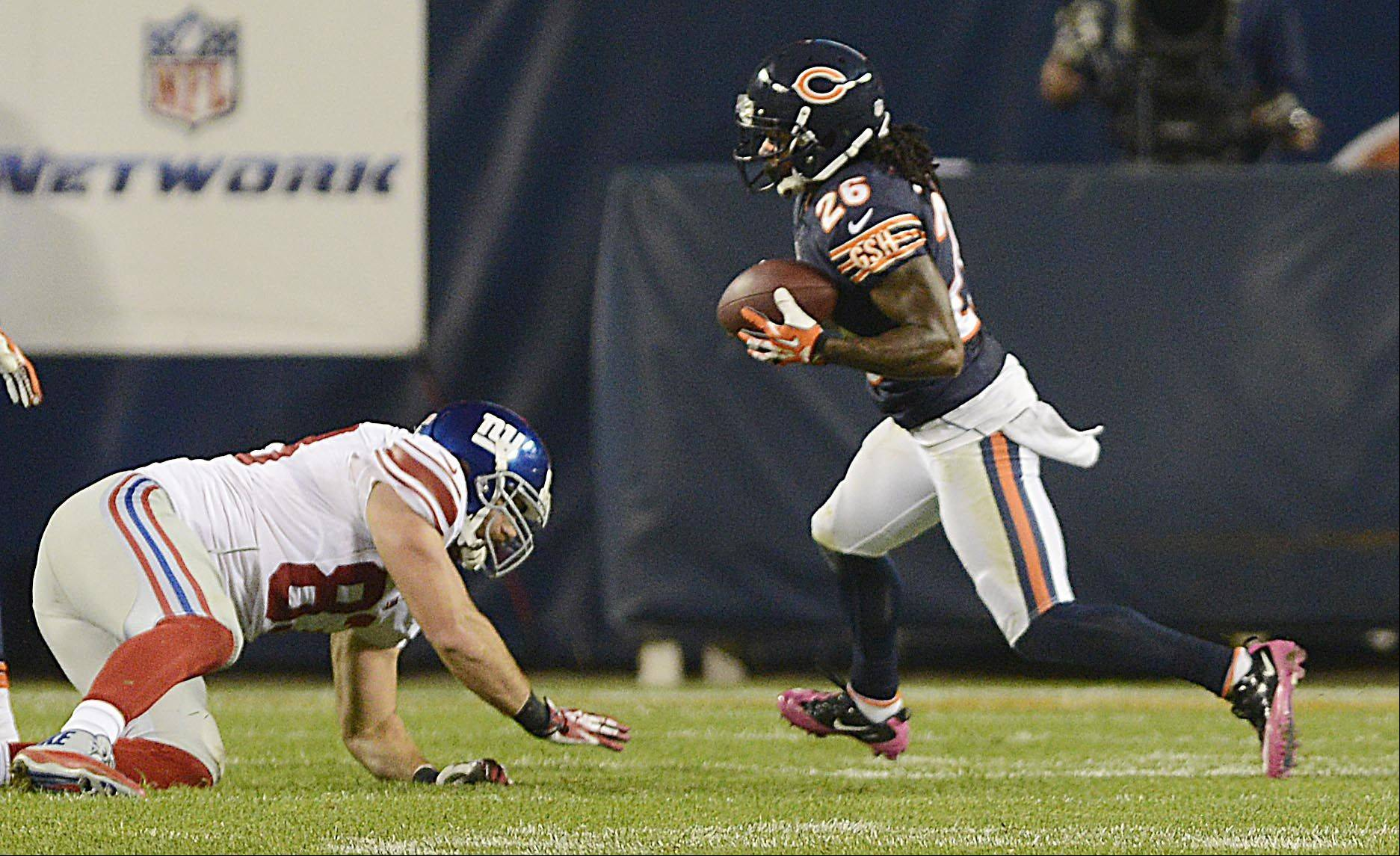 Chicago Bears cornerback Tim Jennings runs back a second interception of the night.