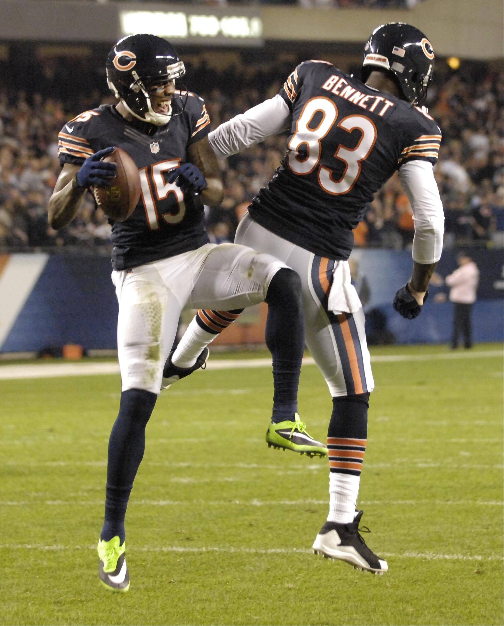 Chicago Bears wide receiver Brandon Marshall celebrates his first touchdown with teammate Martellus Bennett.