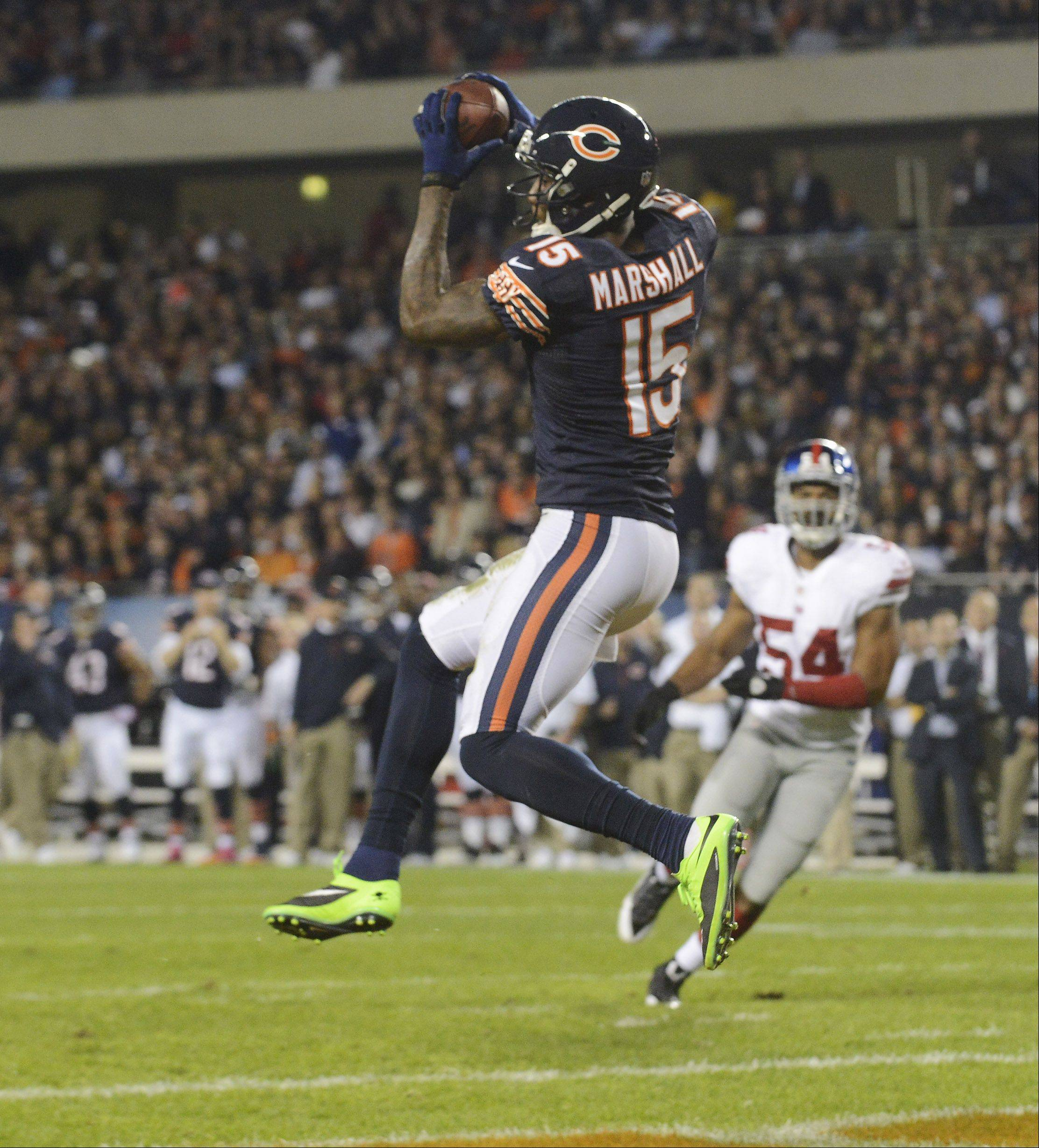 Chicago Bears wide receiver Brandon Marshall makes a touchdown catch during the second quarter .