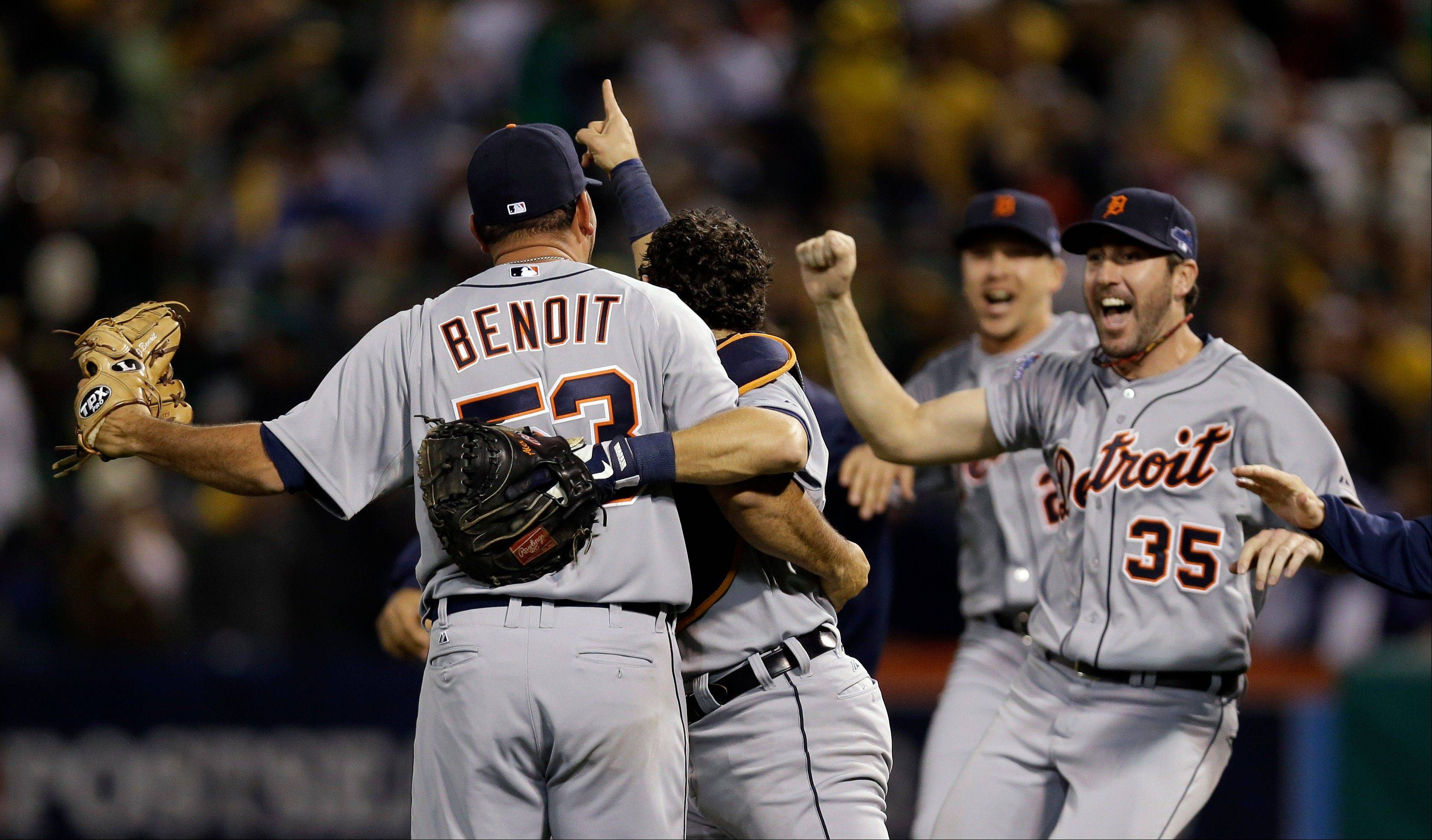 Joaquin Benoit (53), Justin Verlander (35) and catcher Alex Avila celebrate after the Tigers beat the Athletics 3-0 Thursday to win Game 5 of an American League Division Series in Oakland, Calif.