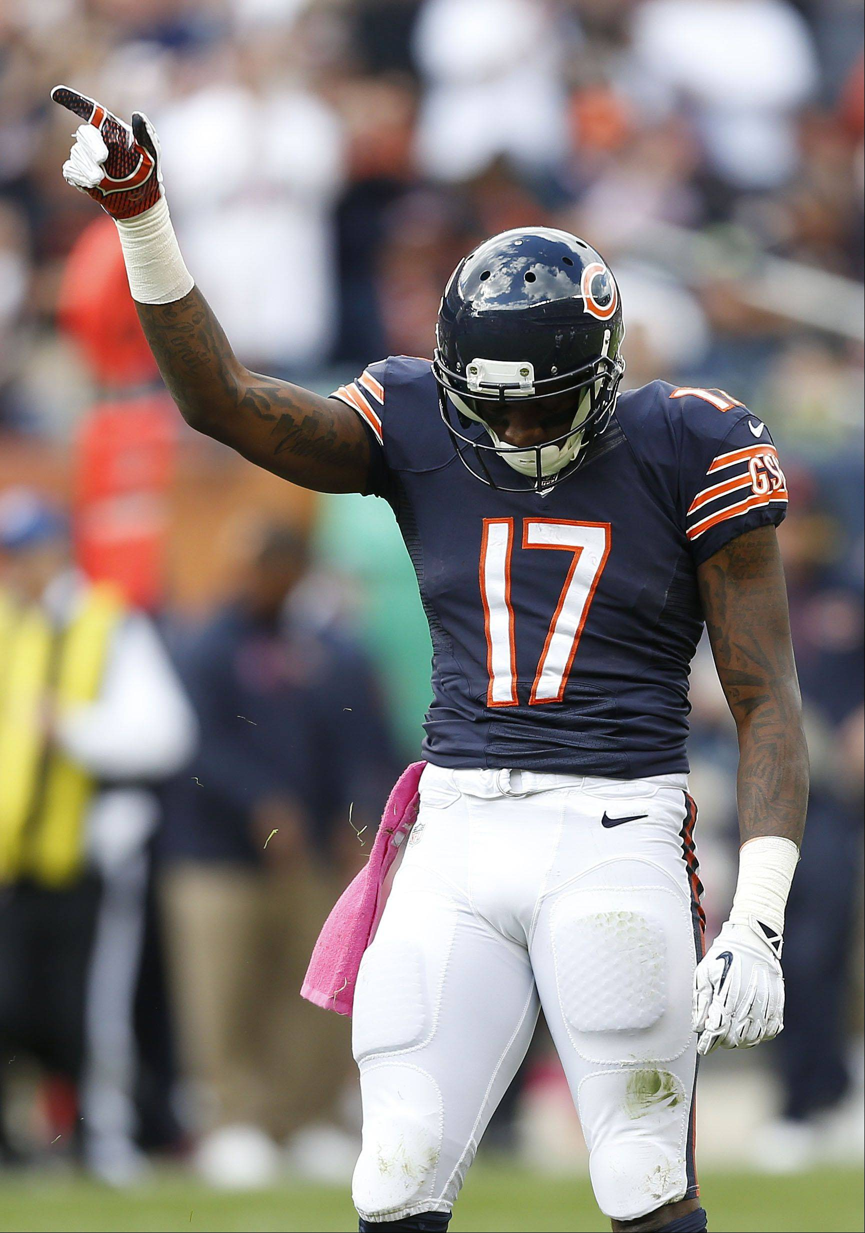 Alshon Jeffery points after a first-down catch during their 26-18 loss Sunday at Soldier Field in Chicago.