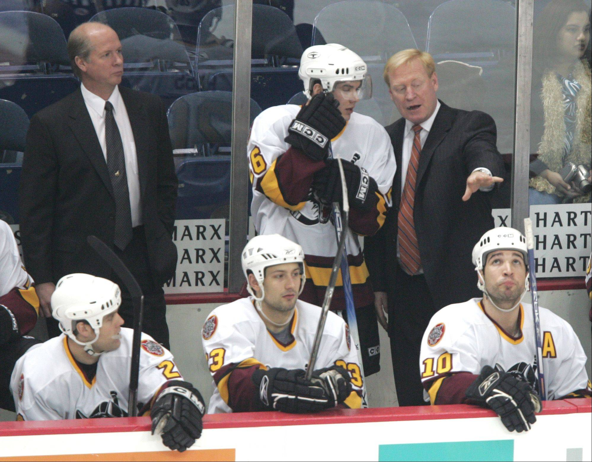 After five years away in the NHL, John Anderson, right, is back coaching the Chicago Wolves, the franchise he led to four titles. The Wolves will host their home op