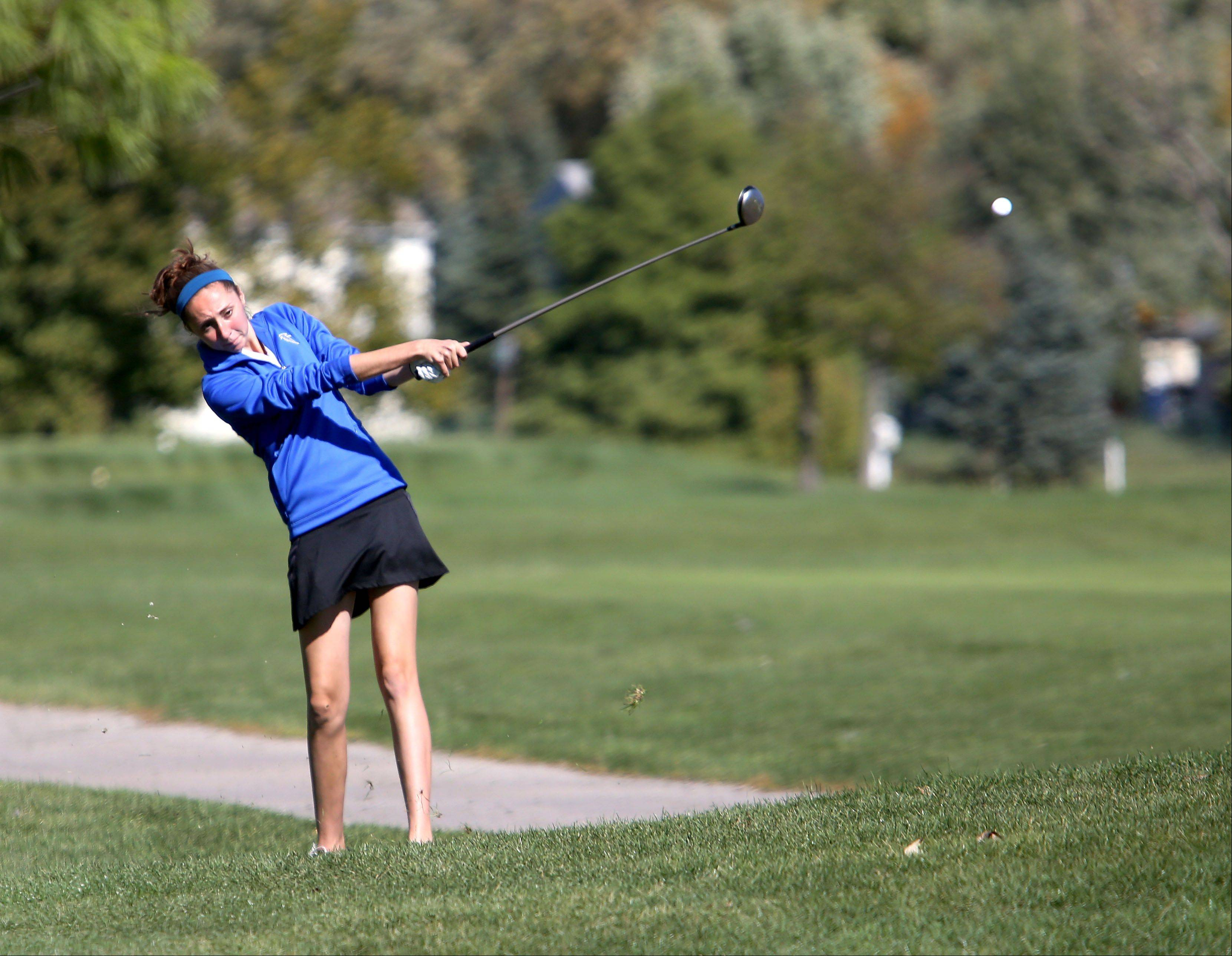 Caitlin Berry of Wheaton North hits on the 11th fairway during Class AA Glenbard East regional girls golf at Glendale Lakes Golf Course in Glendale Heights on Wednesday.