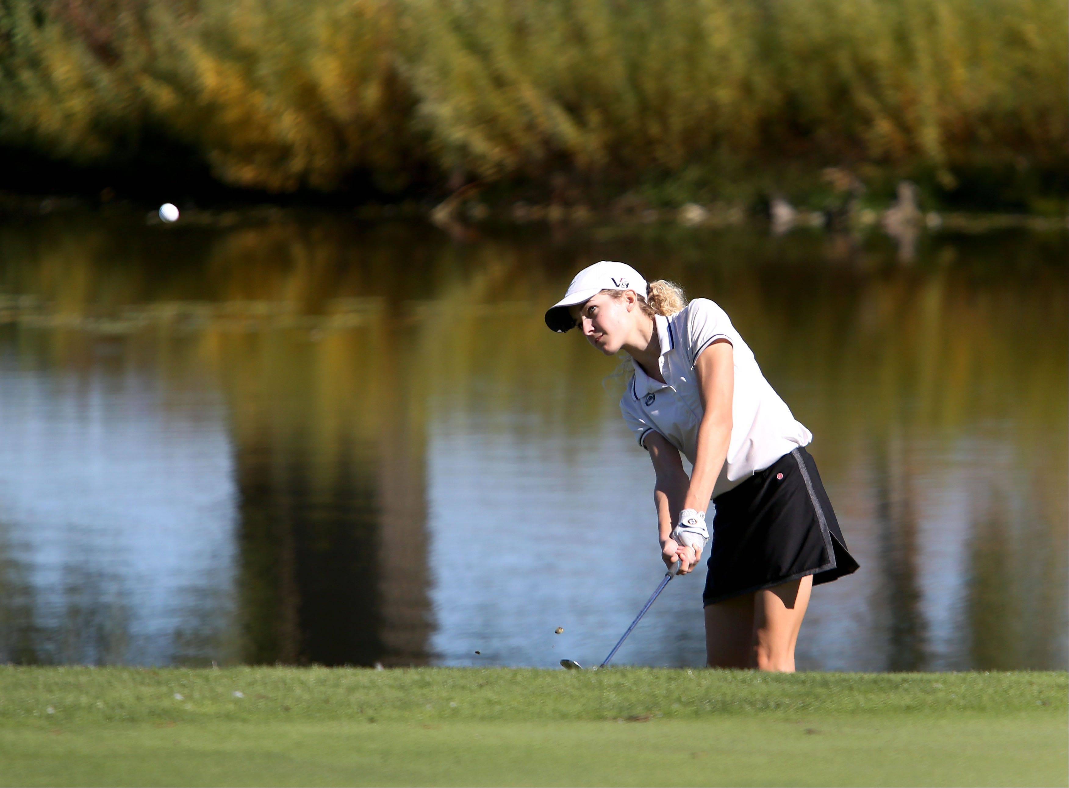 Emma Klimala of Glenbard West watches her chip shot onto the third green during Class AA Glenbard East regional girls golf at Glendale Lakes Golf Course in Glendale Heights on Wednesday.