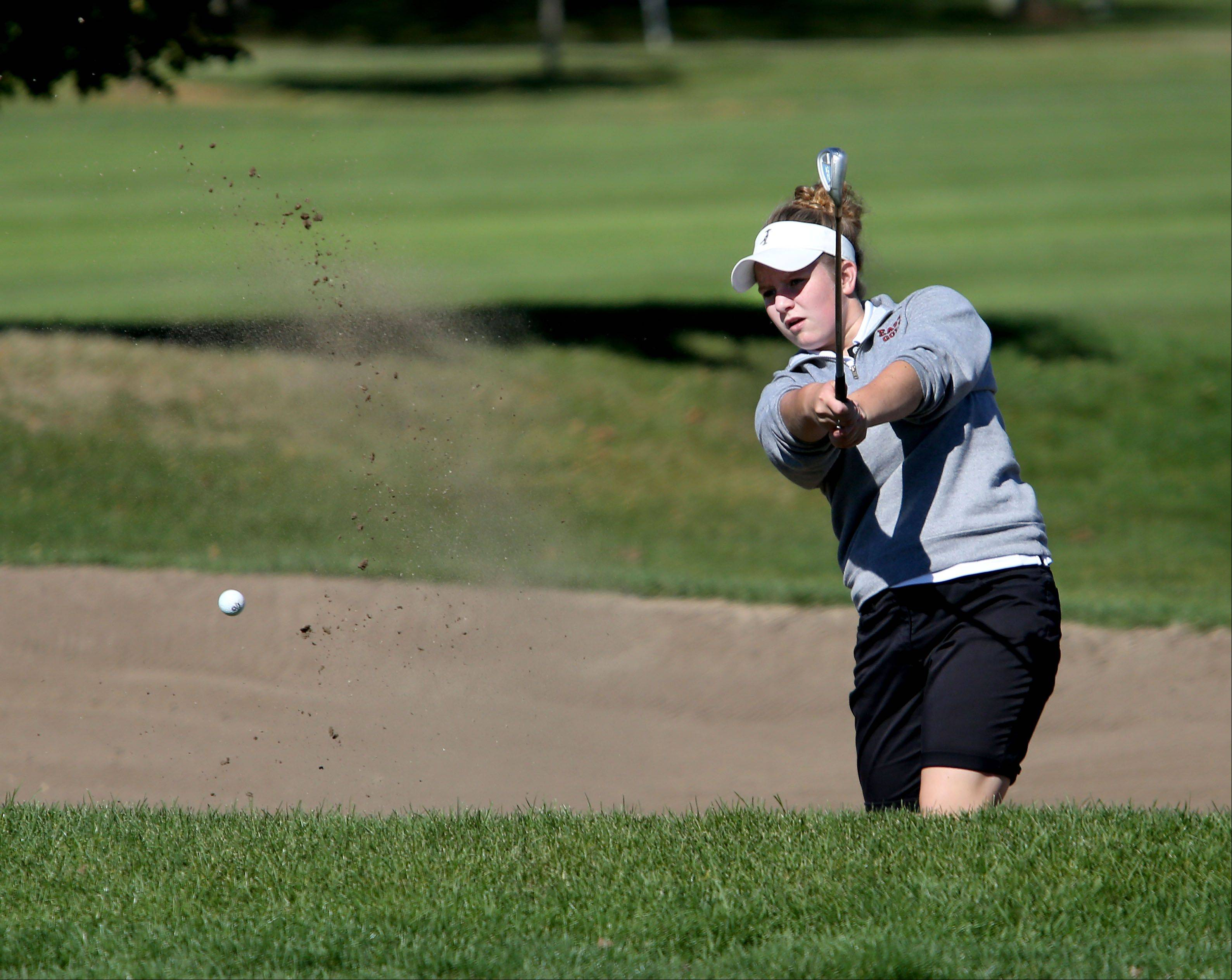 Anna Mahay of Glenbard East, blasts out of the sand on the first green during Class AA Glenbard East regional girls golf at Glendale Lakes Golf Course in Glendale Heights on Wednesday.