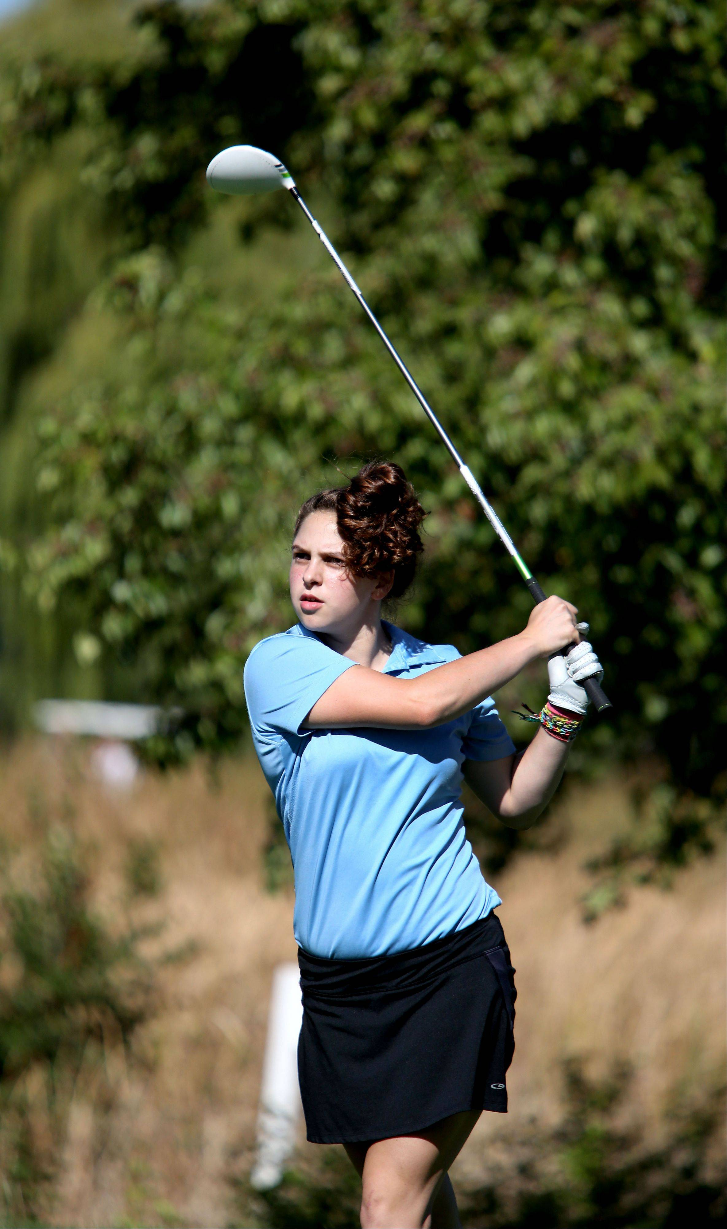 Anna Dinella of Willowbrook watches her shot on the first tee during Class AA Glenbard East regional girls golf at Glendale Lakes Golf Course in Glendale Heights on Wednesday.