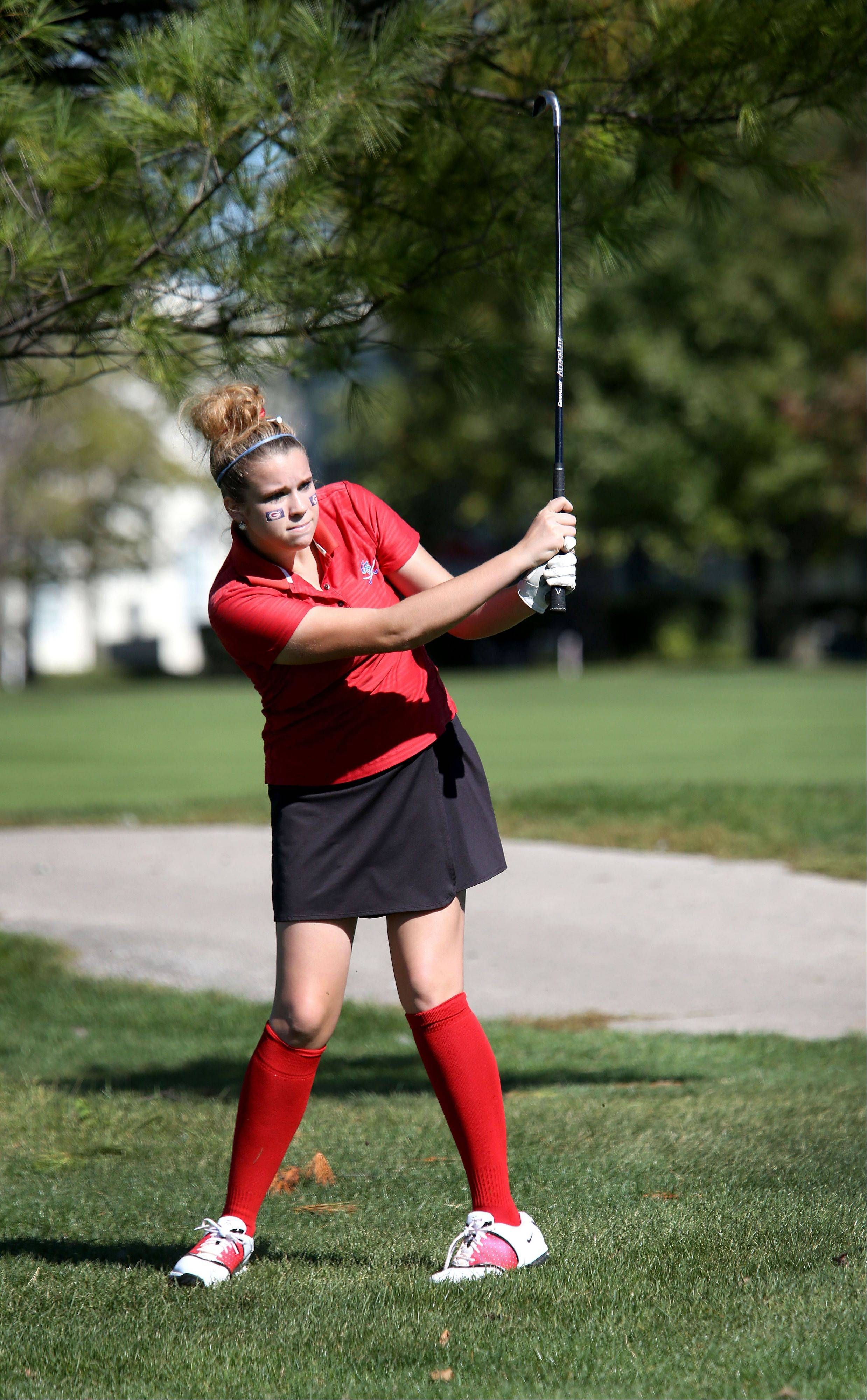 Abby Johnson of Glenbard South watches her shot on the 11th green during Class AA Glenbard East regional girls golf at Glendale Lakes Golf Course in Glendale Heights on Wednesday.