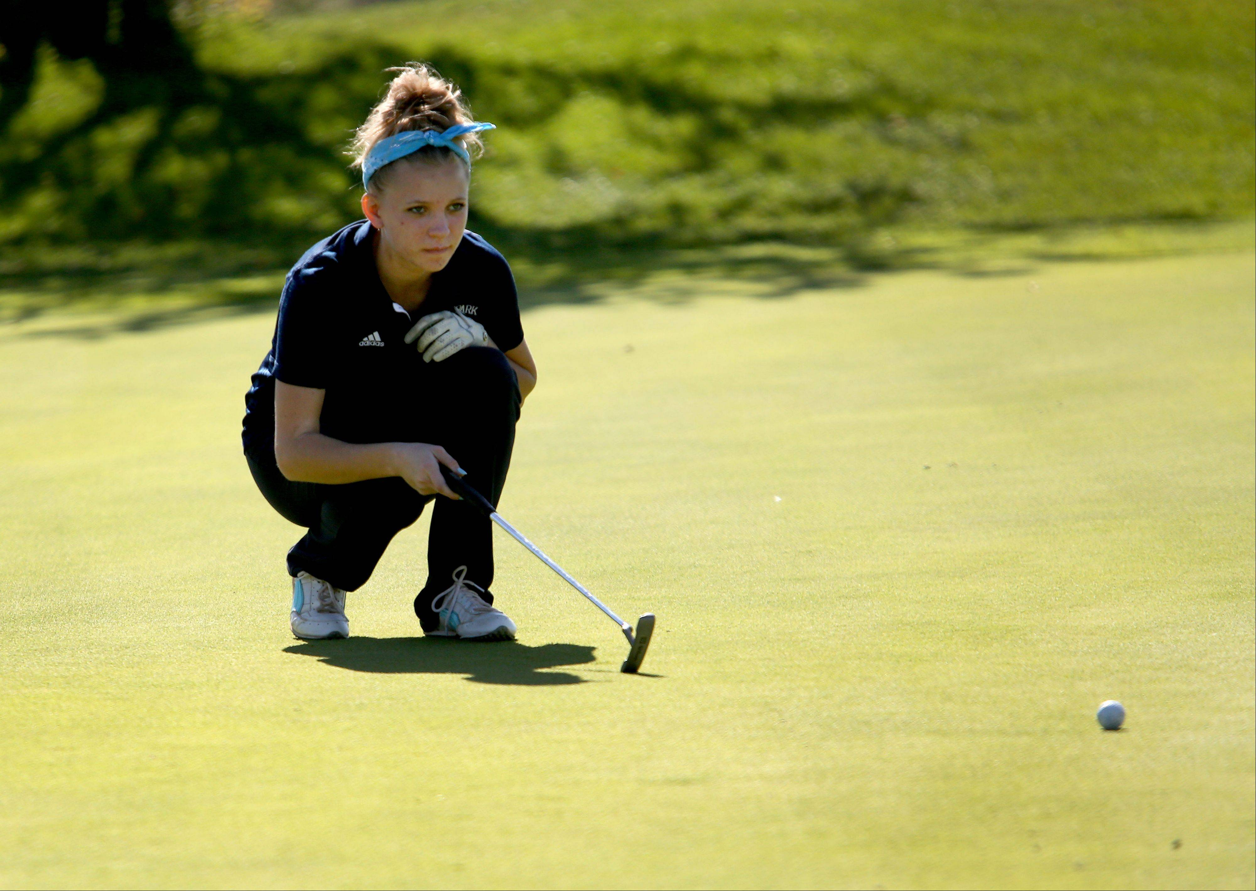 Madison McCallister of Lake Park lines up a putt on the first green during Class AA Glenbard East regional girls golf at Glendale Lakes Golf Course in Glendale Heights on Wednesday.