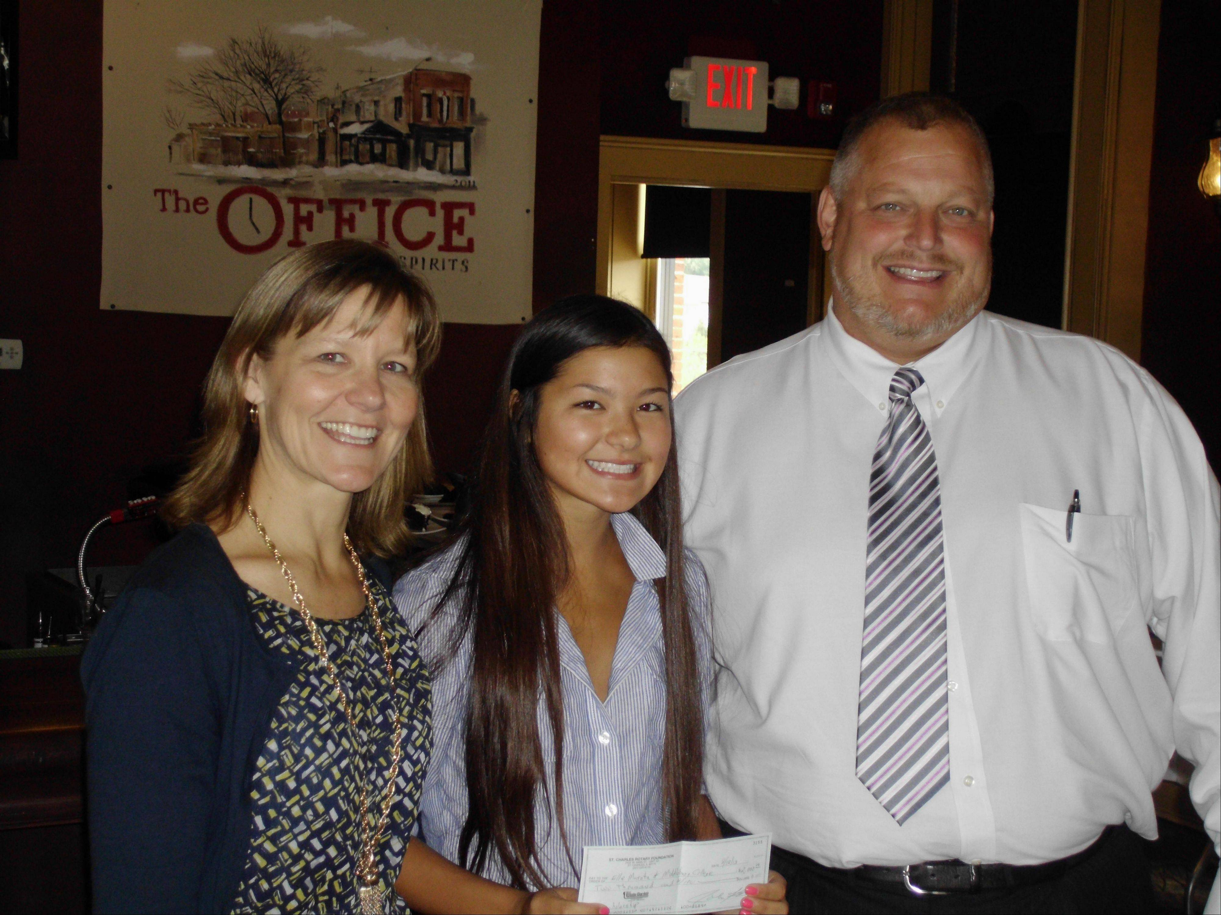 St. Charles Rotary Foundation President Dean Carlson, right, congratulates scholarship winner Elle Murata, with her mother, Kathy Murata.
