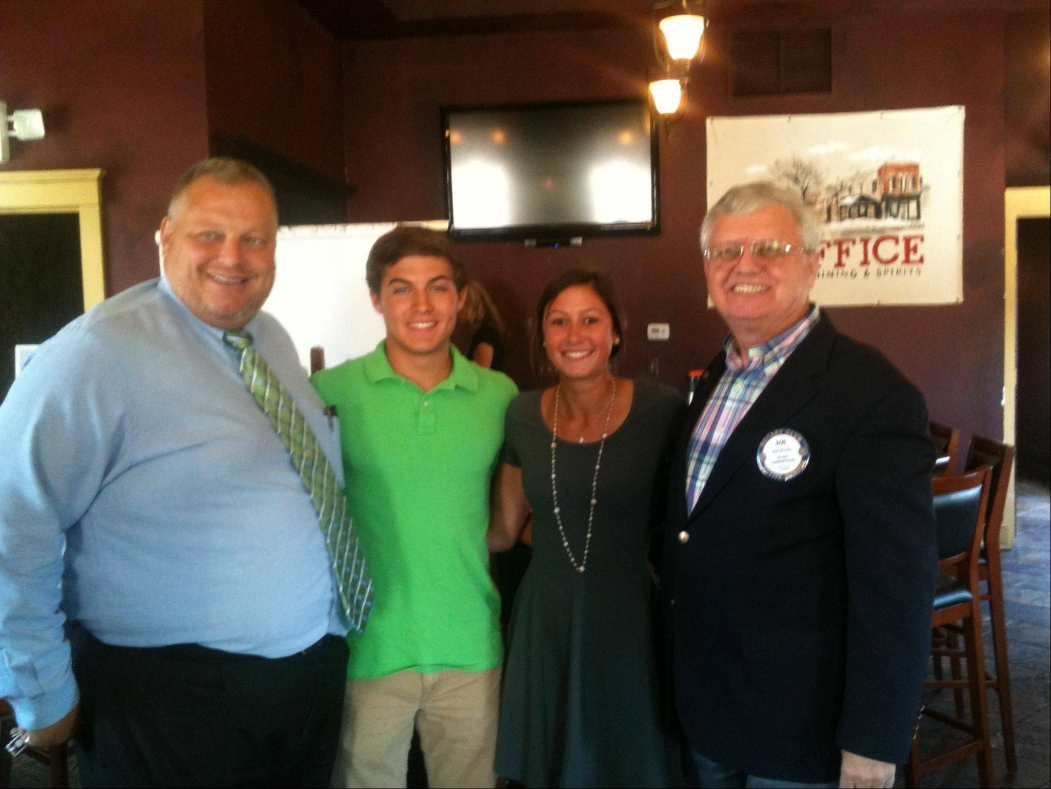St. Charles Rotary scholarship winners Alex O'Brien and Maria Ranieri join St. Charles Rotary Foundation President Dean Carlson and Rotary Club President Bob Brown.