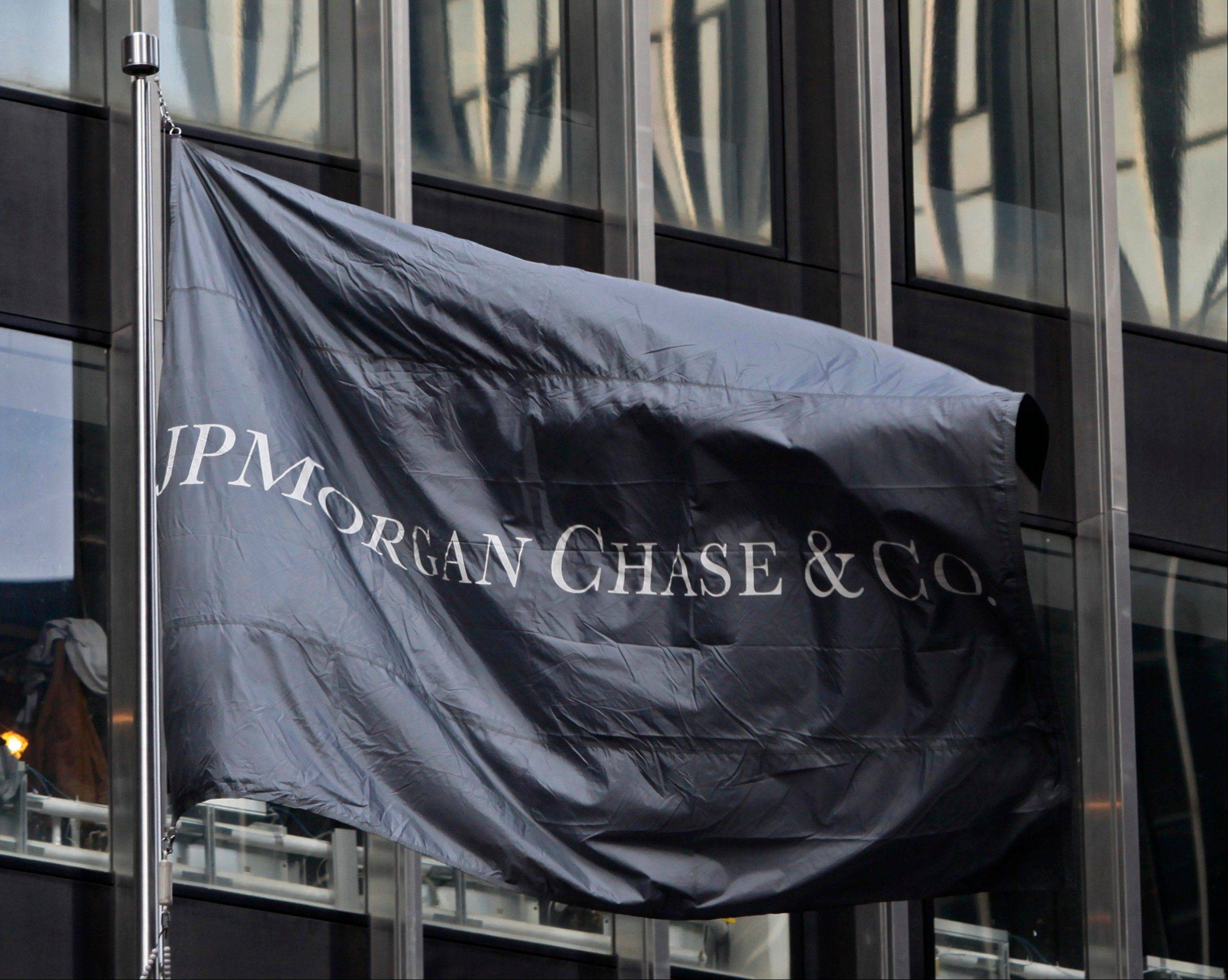 JPMorgan Chase, the biggest U.S. bank by assets, is reporting a surprise third-quarter loss after a big charge for legal expenses.
