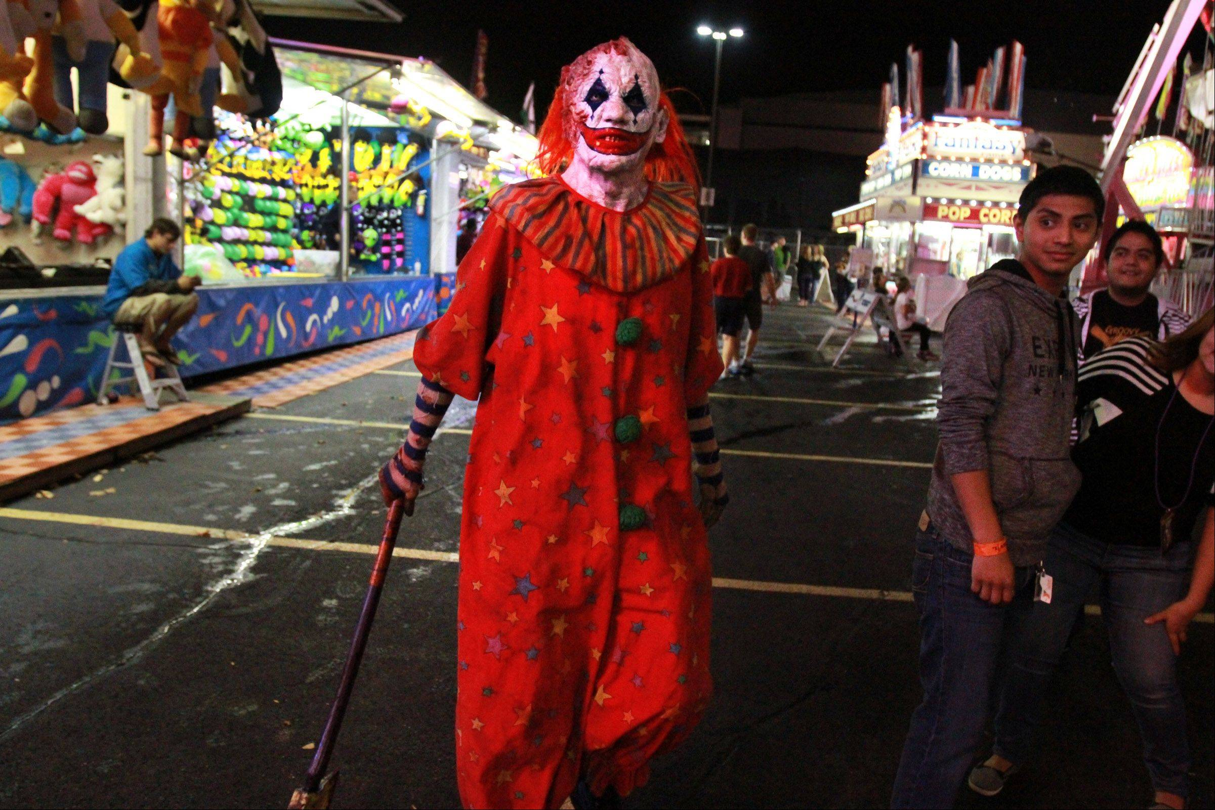 CarnEvil the clown (played by James Caraway of Rockford) scares visitors to the new haunted attraction that shares his name. It's at the Sears Centre in Hoffman Estates.
