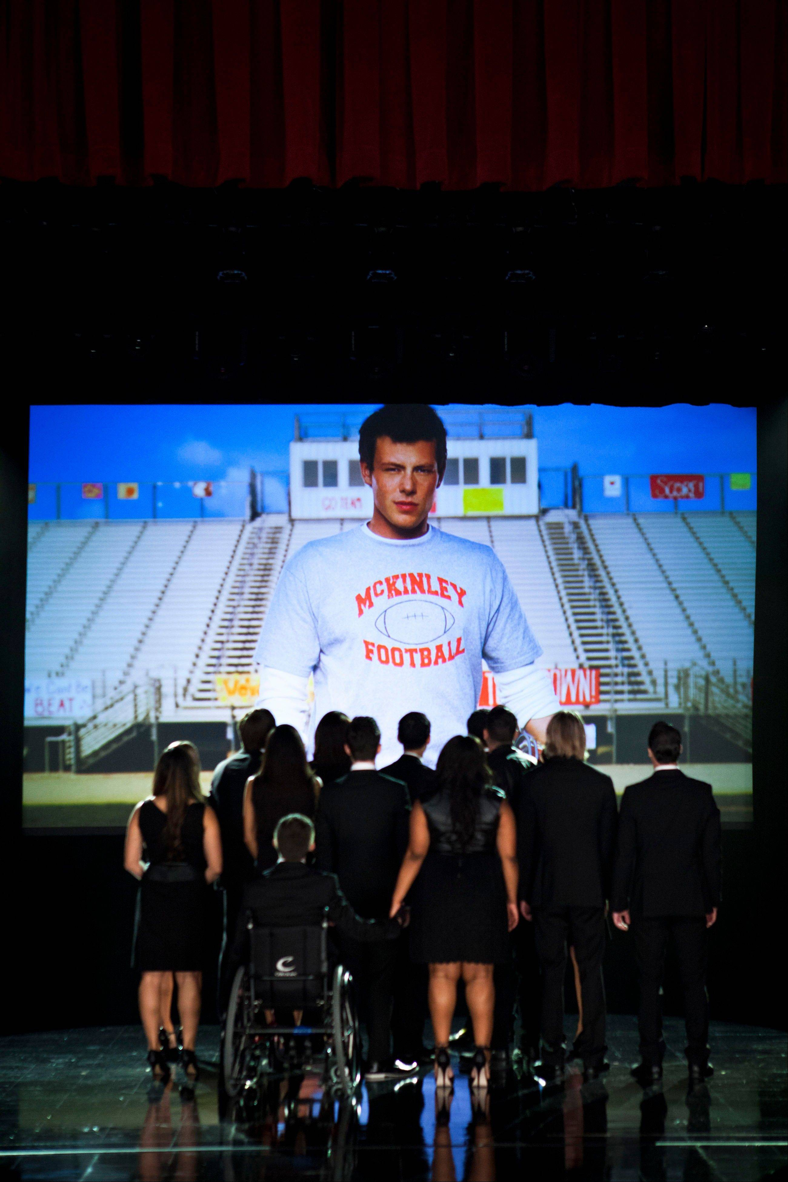 The McKinley family of the past and present joined together to remember and celebrate the life of Finn Hudson in �The Quarterback� episode of �Glee.� The high school musical drama said goodbye to Finn, its beloved singer-quarterback, while paying tribute to Cory Monteith, the late actor who had portrayed him, in a much-anticipated episode that aired Thursday.