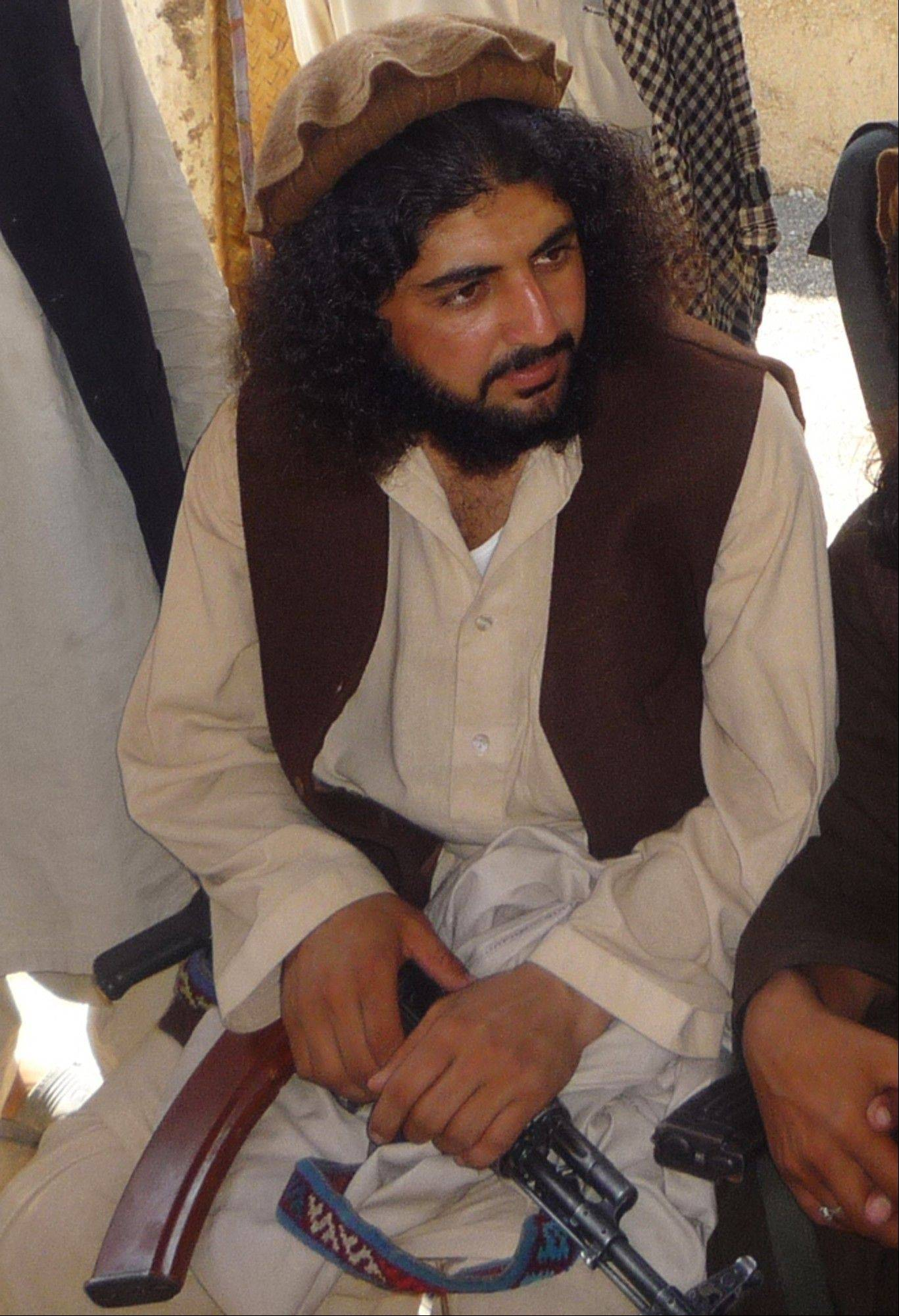 Pakistani Taliban commander Latif Mehsud sits with fellows in Sararogha in south Waziristan in Pakistan.