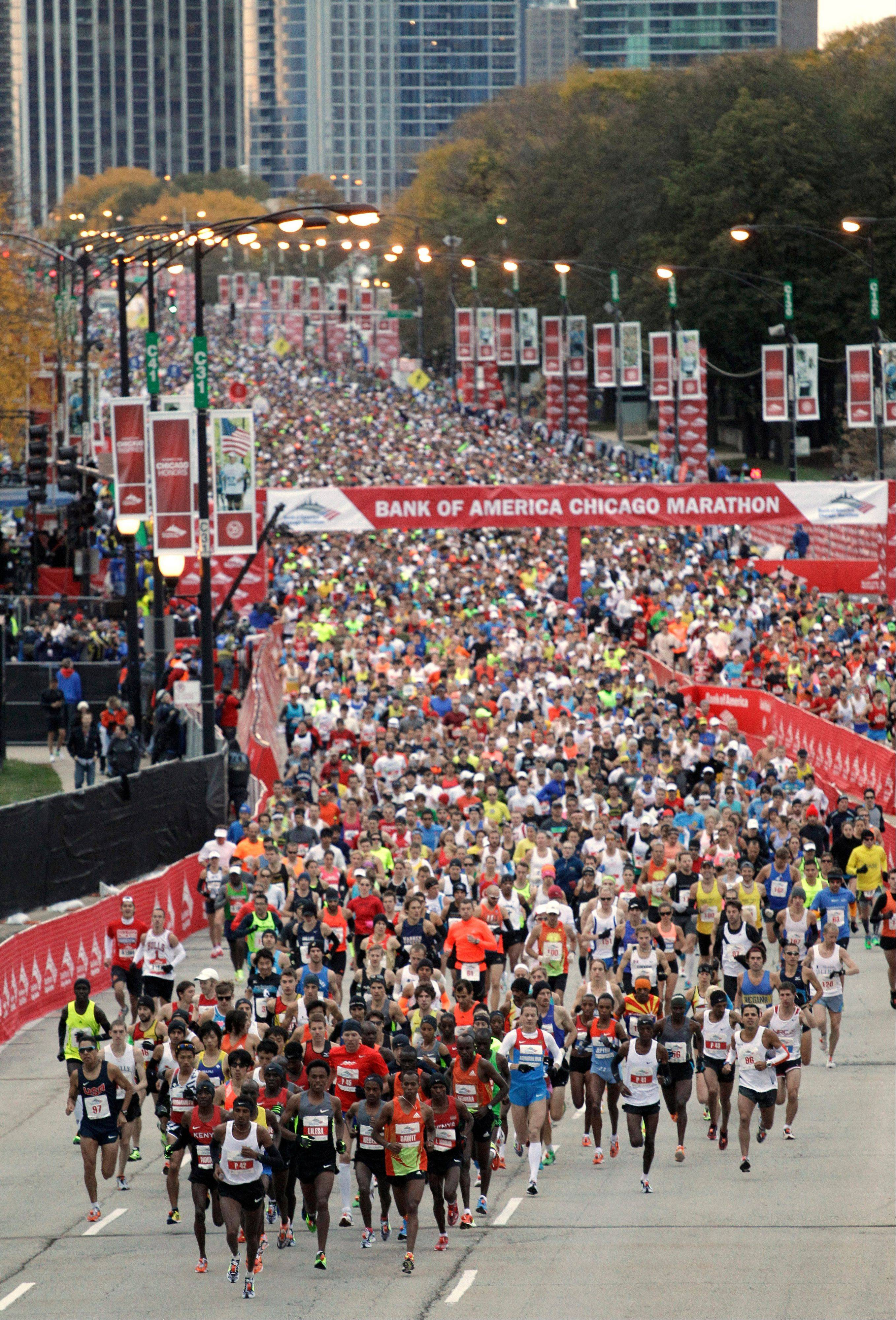 Runners leave the starting line during the 2012 Chicago Marathon. About 45,000 athletes will participate in this year�s race, which will begin at Grant Park on Sunday morning.