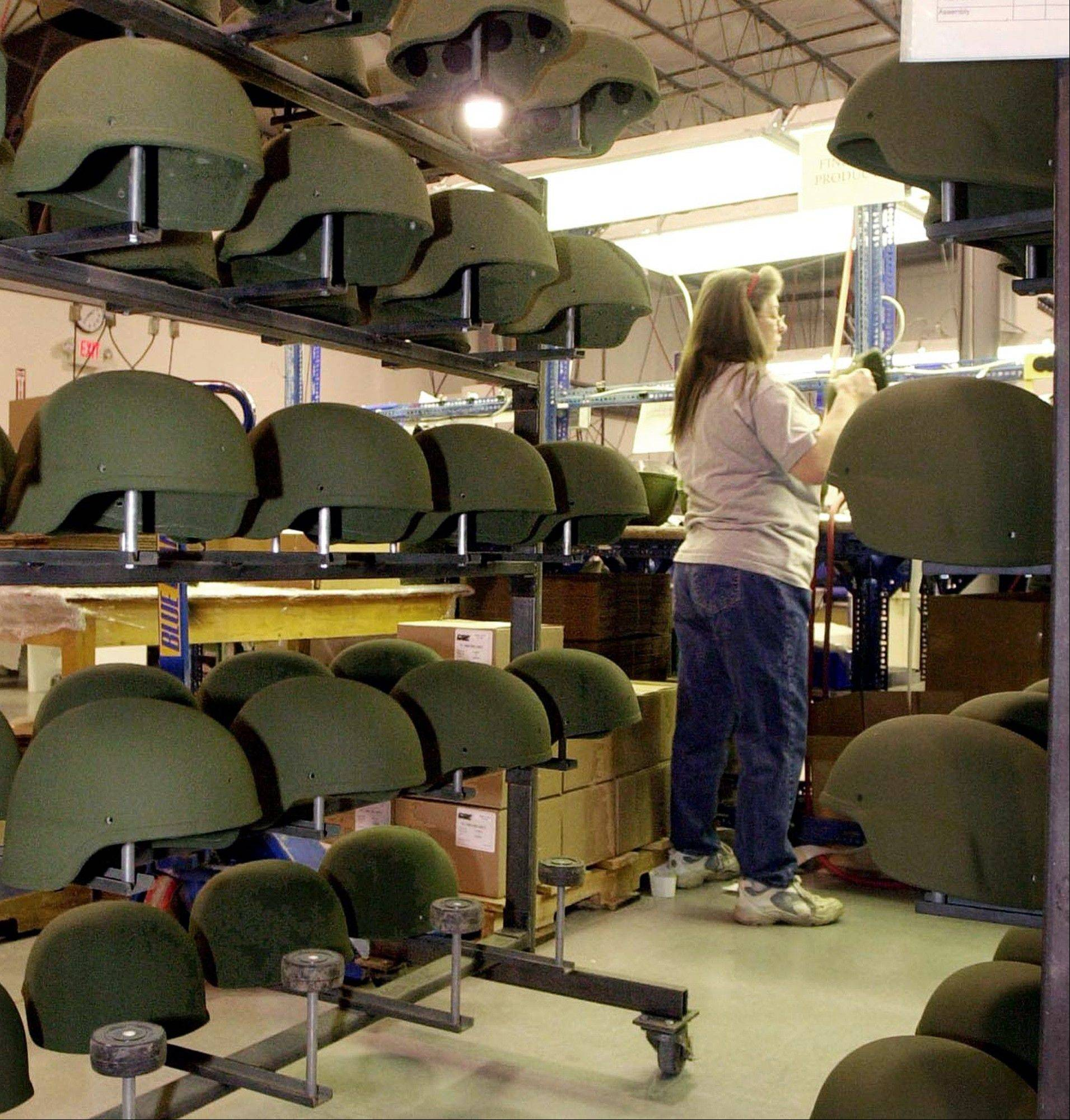 A rack of military helmets awaits final preparation at the Revision Military plant in Newport, Vt. The Vermont plant that makes helmets for the U.S. military has laid off half its workforce because of uncertainty created by the federal budget impasse. Revision Military cut the number of workers at its Newport plant at the beginning of the federal government shutdown last week.