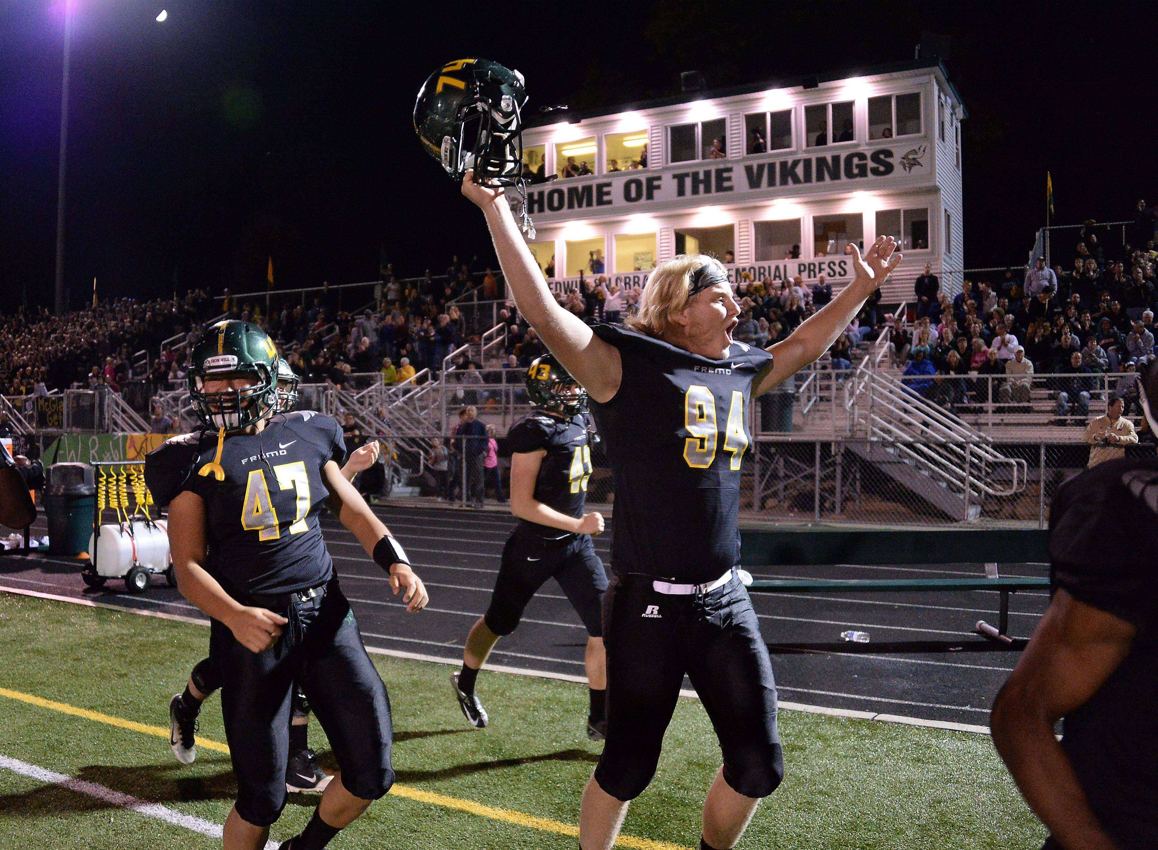 Jack Albrecht and his Fremd teammates start to celebrate against visiting Palatine in the fourth quarter Friday night at Fremd.
