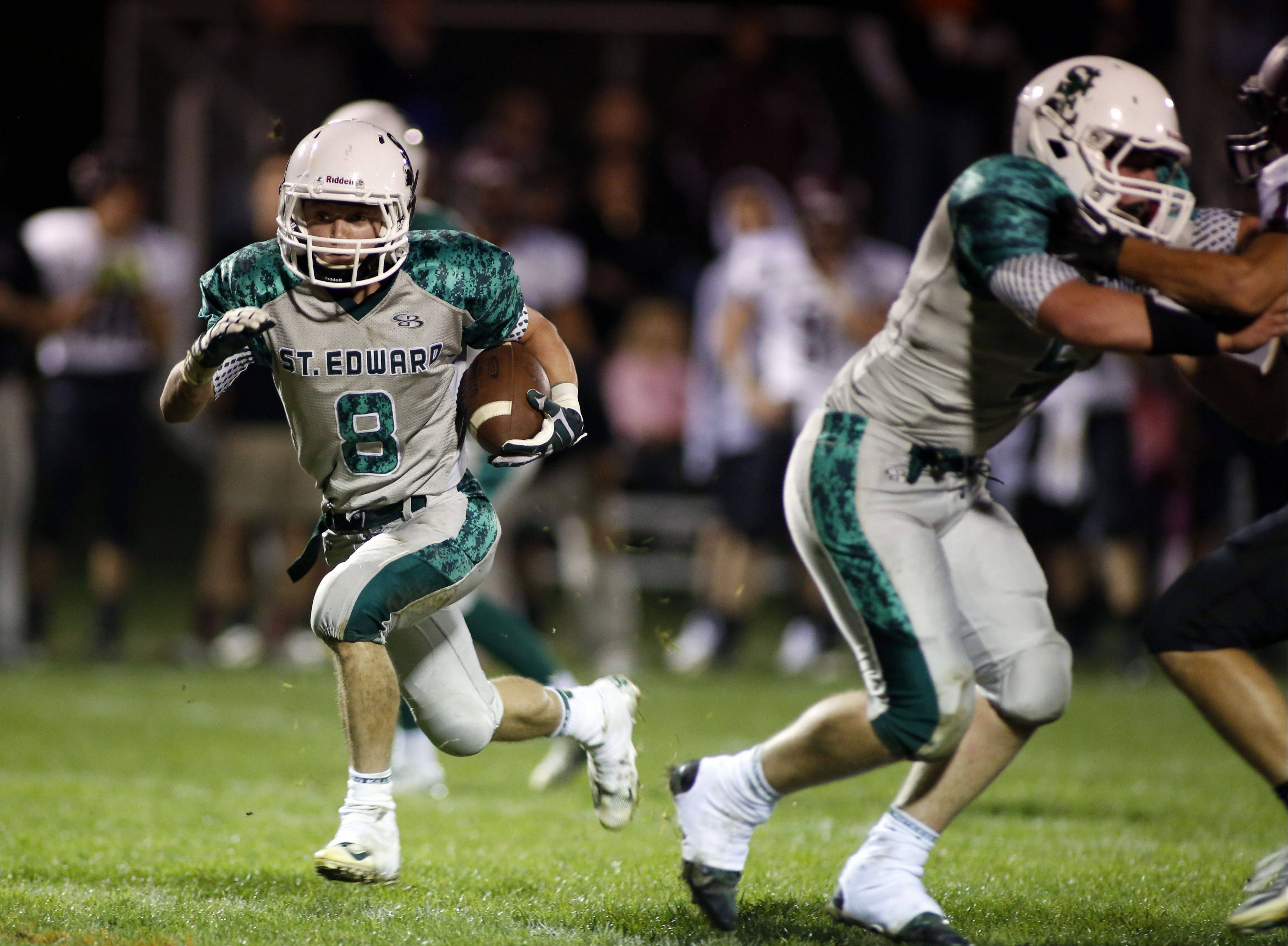 St. Edward�s Michael Castoro rumbles in for a touchdown during the Green Wave�s victory over Wheaton Academy on Friday at Greg True Field in Elgin.