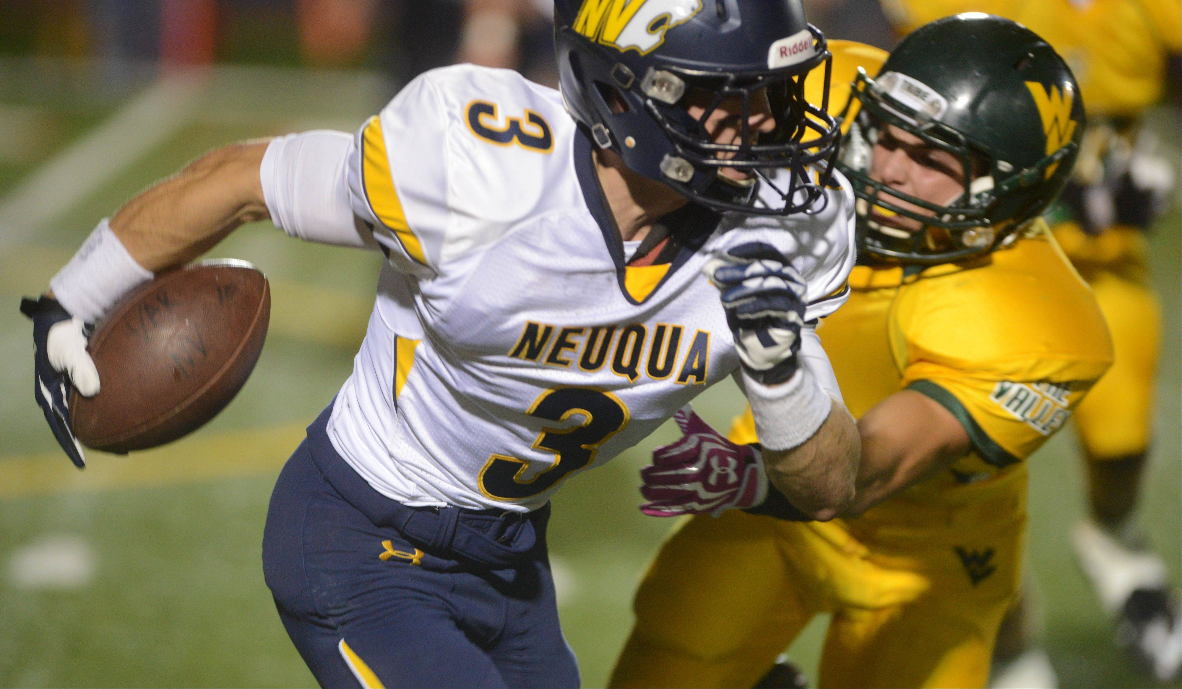 Mikey Dudek of Neuqua Valley runs the ball during the Wildcats� win over Waubonsie Valley at North Central College Friday.