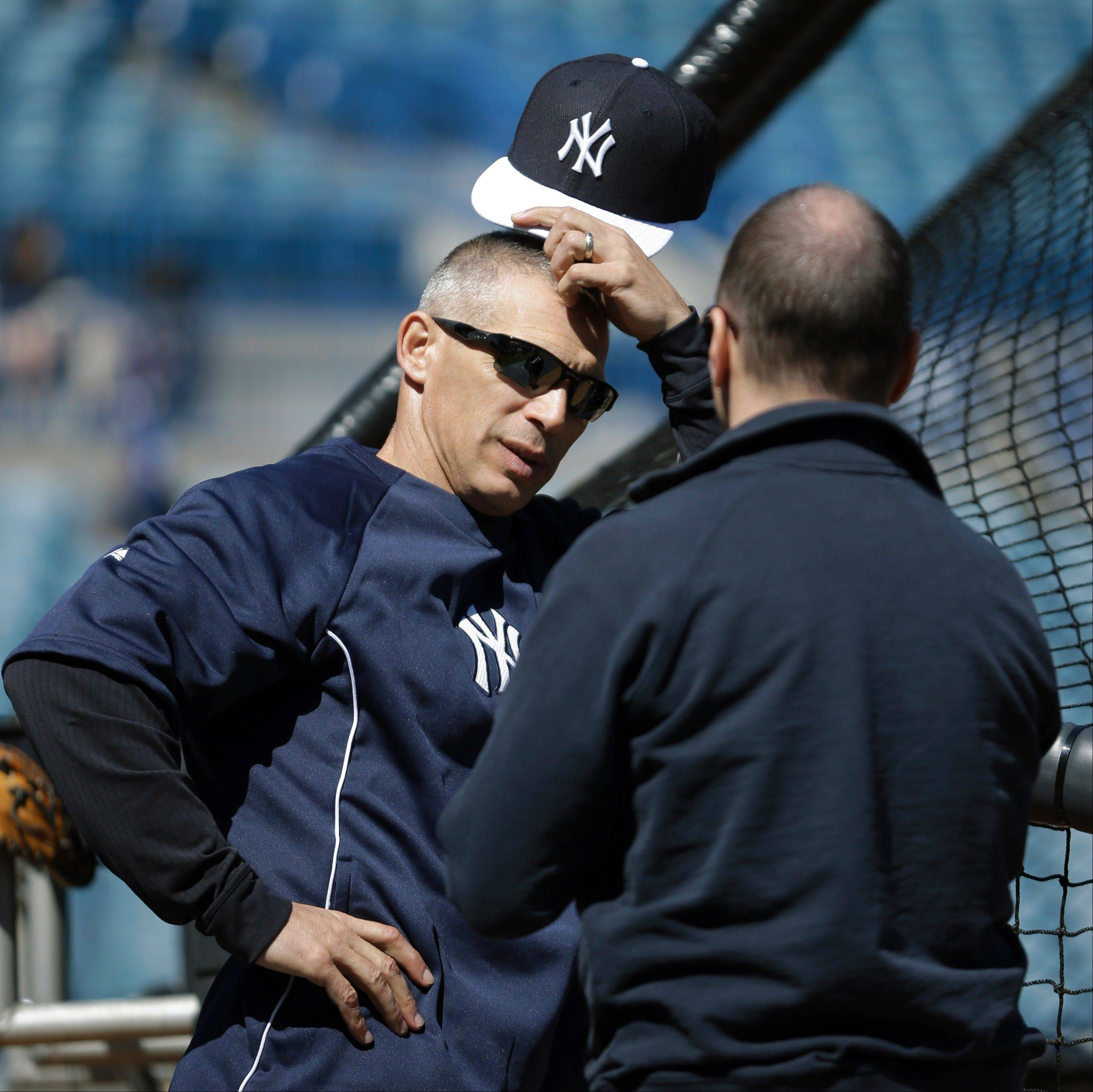 New York Yankees general manager Brian Cashman was able to convince Joe Girardi, left, to stay in New York and manage his baseball team. Girardi agreed to a four-year deal.