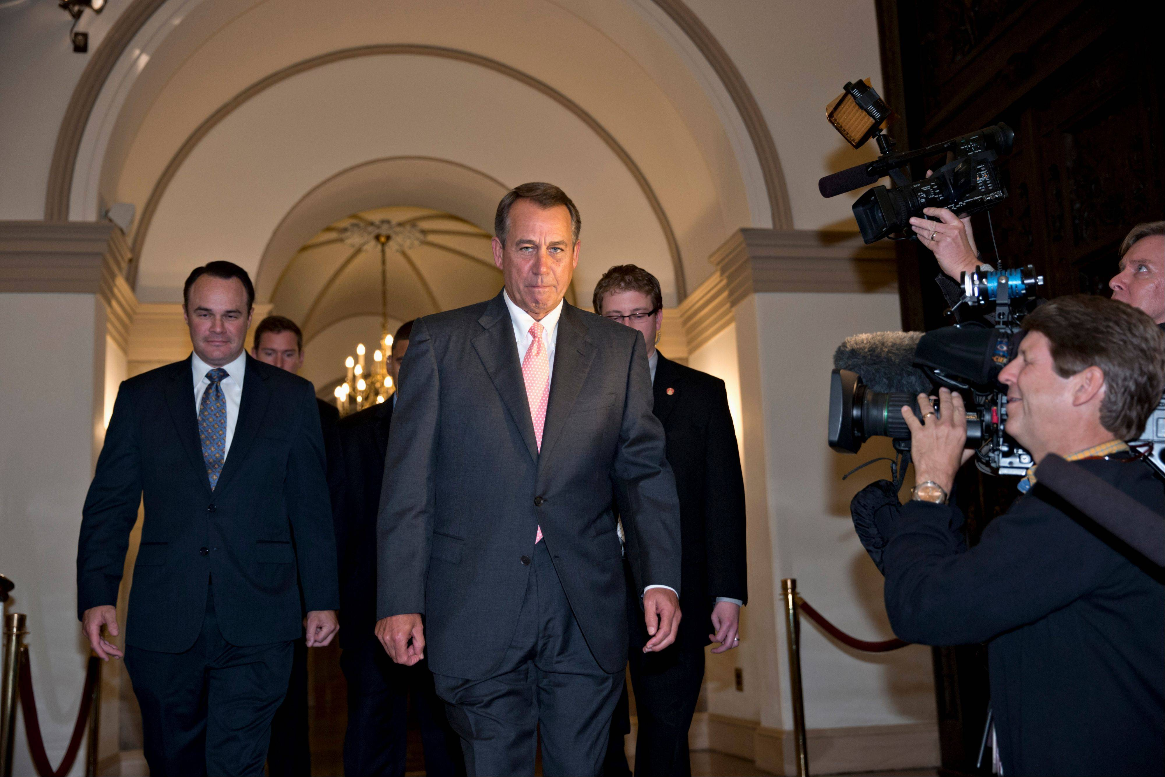 House Speaker John Boehner of Ohio departs the Capitol in Washington, Thursday en route to the White House to meet with President Barack Obama about a solution to ending the government shutdown.