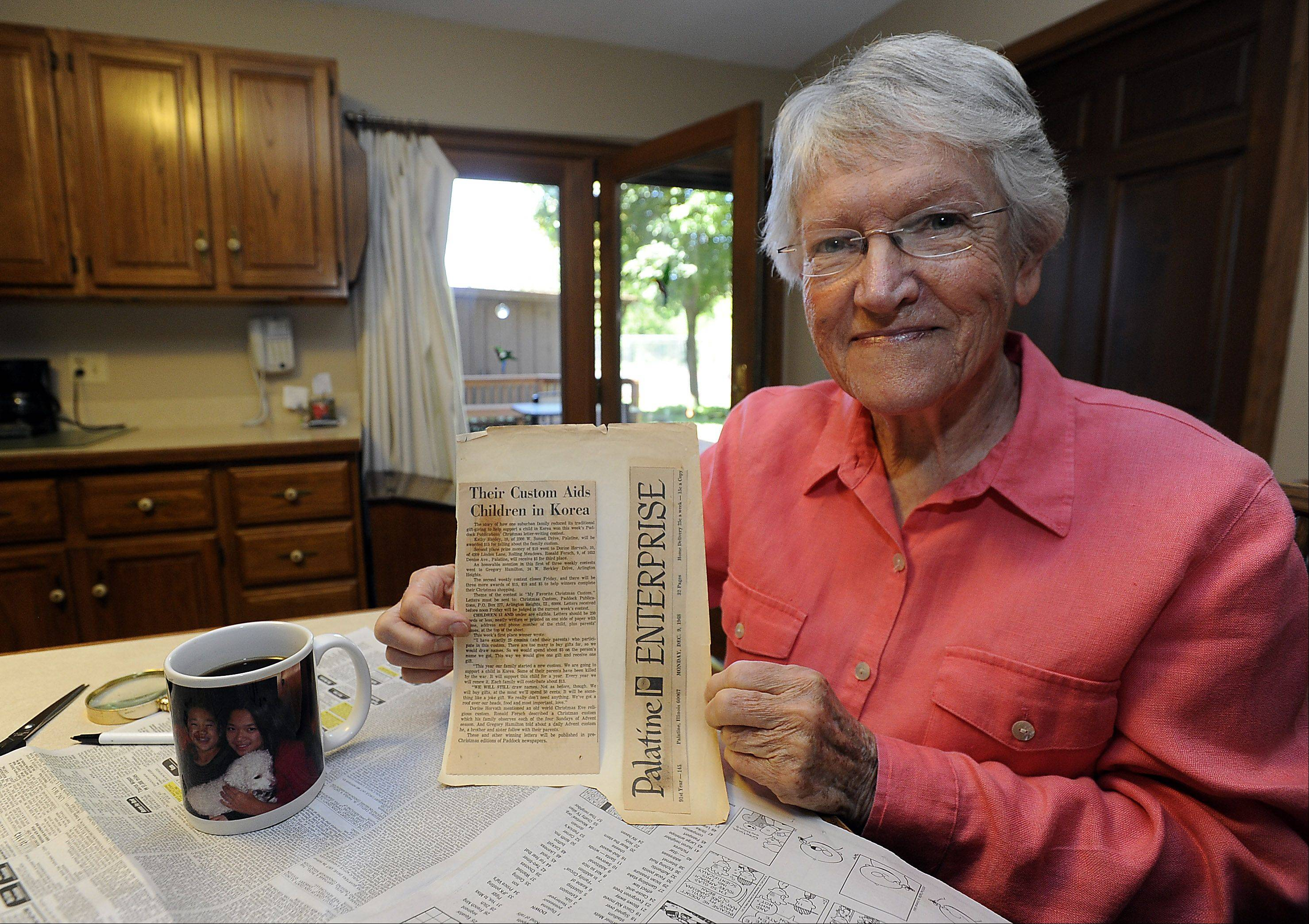 Annette Hayley of Palatine sits down in the morning with her cup of coffee and reads the Neighbor section of the Daily Herald, her favorite section. She has been a loyal reader since 1965, here showing off a section from a past issue.