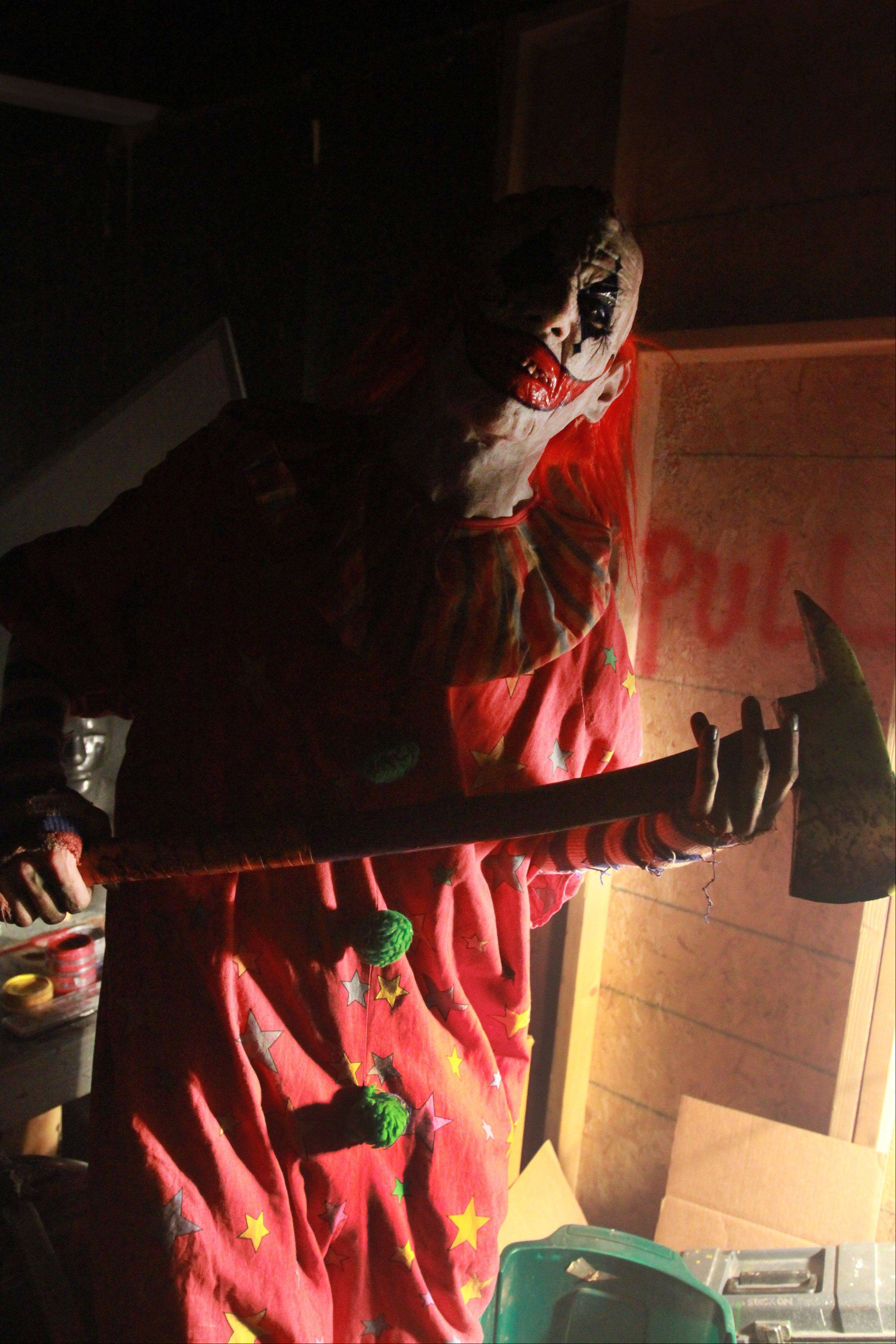 CarnEvil the clown (played by James Caraway of Rockford) scares visitors to CarnEvil, new haunted attraction at the Sears Centre in Hoffman Estates.