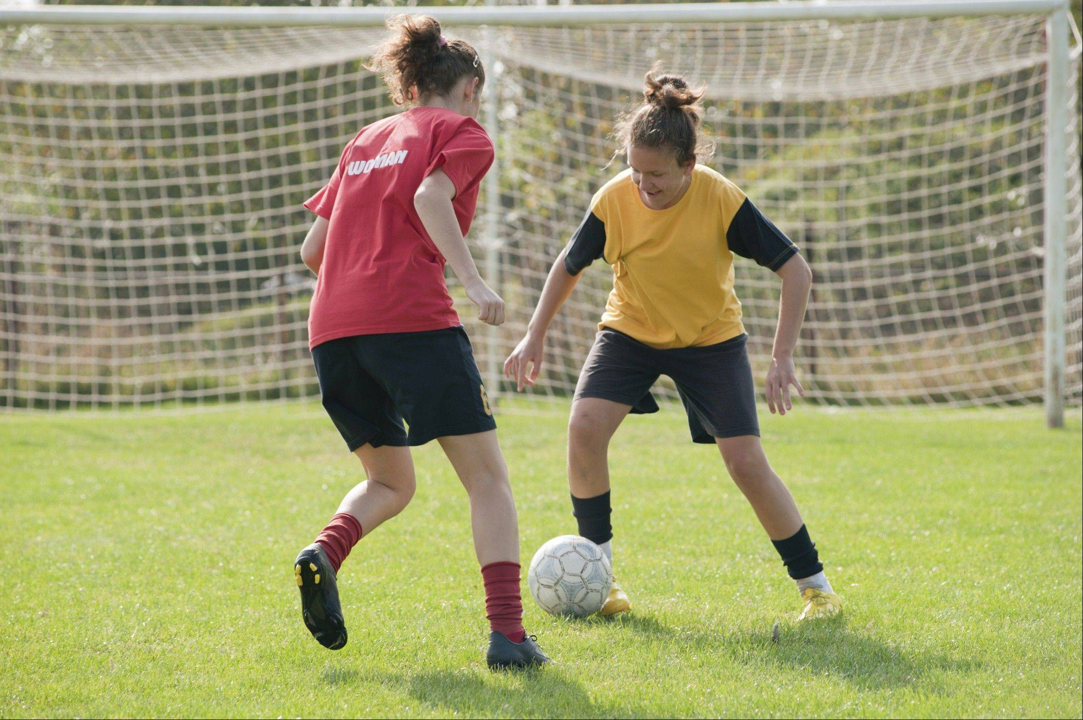 Girls and women are more likely to suffer concussions than boys and men in comparable sports such as soccer, baseball and basketball, say researchers.