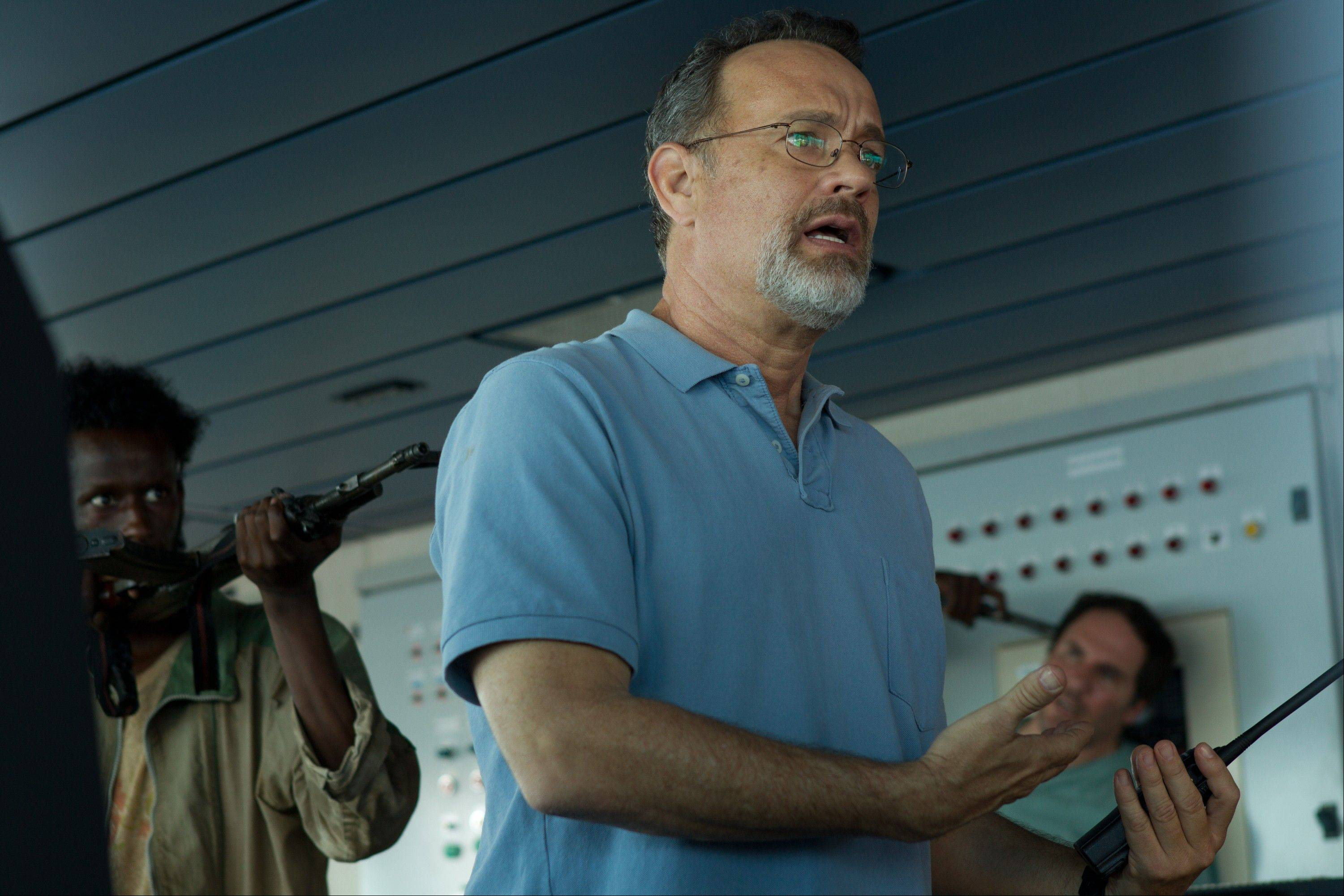 "Tom Hanks -- who has made a career out of playing ordinary guys -- plays the most regular Joe of them all: a working-class, cargo ship captain from Vermont in ""Captain Phillips."""