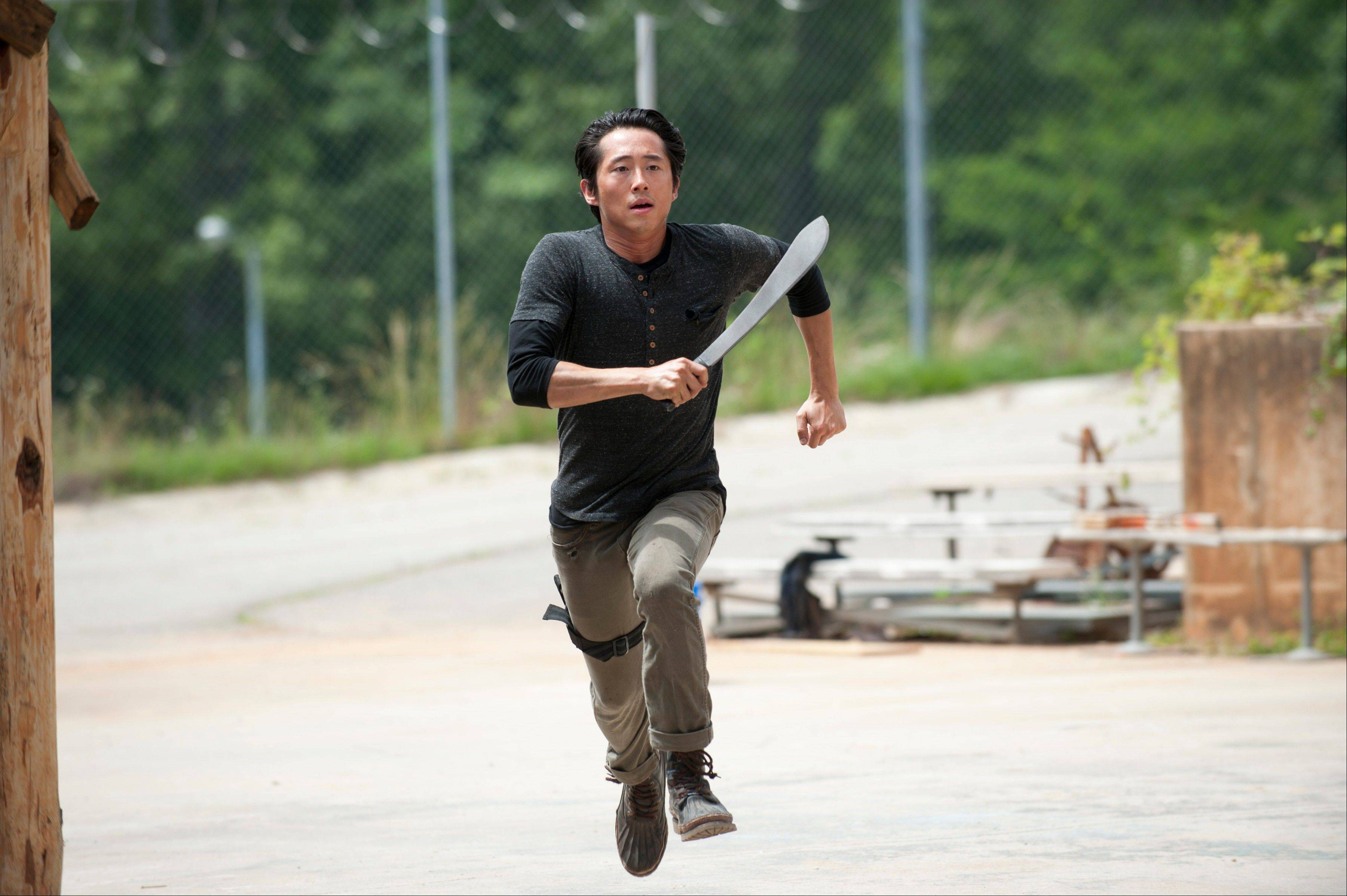 "How long will Glenn (Steven Yeun) survive in season four of AMC's ""The Walking Dead,"" which premieres at 8 p.m. Sunday, Oct. 13."