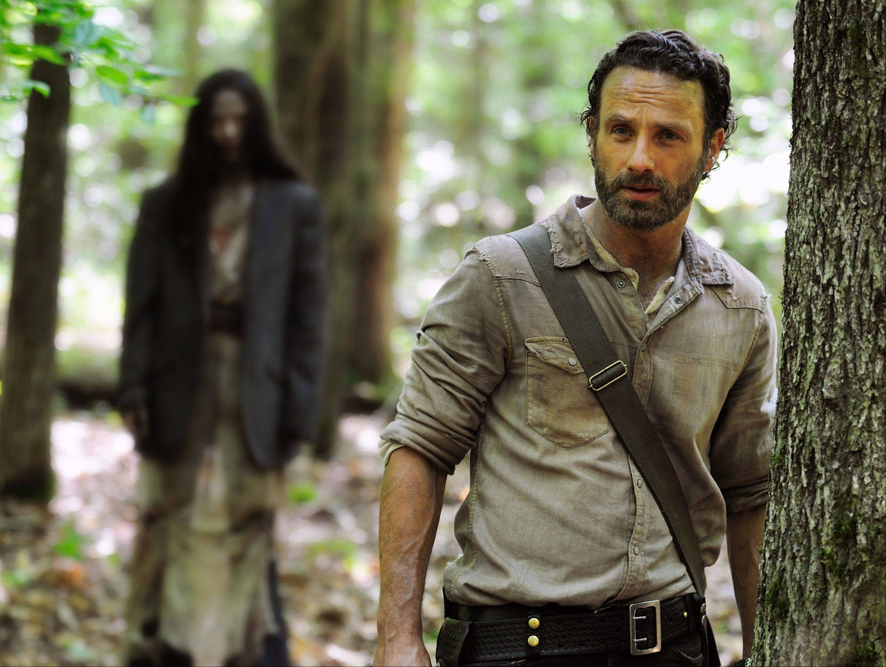 "Rick Grimes (Andrew Lincoln) is still dodging walkers in season four of ""The Walking Dead."""