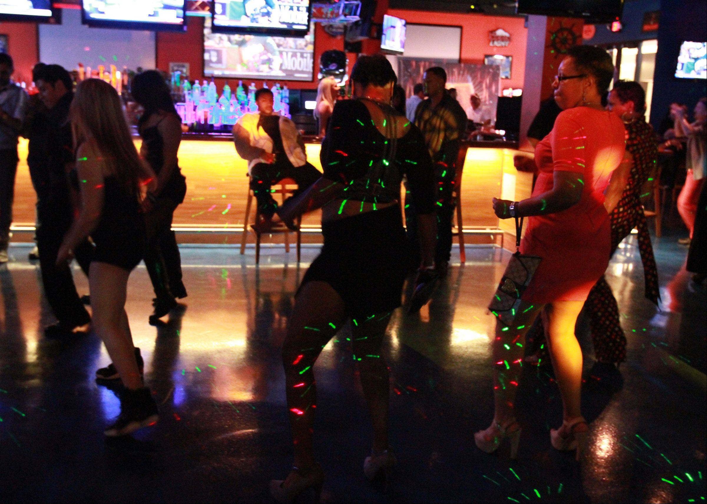 Patrons hit the dance floor at midnight at All Stars On Board in Vernon Hills.