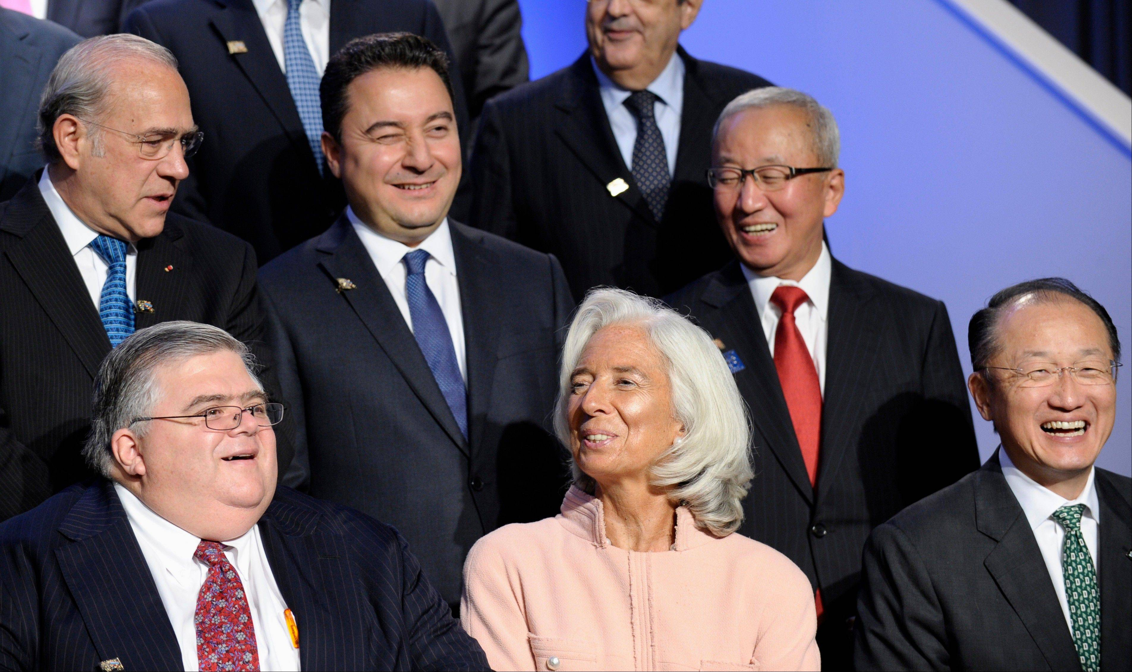 International Monetary Fund Managing Director Christine Lagarde, front row, center, flanked by Mexican central bank Governor Agustin Carstens, left, and World Bank President Jim Yong Kim, front row, right, poses Friday with the Group of 20.