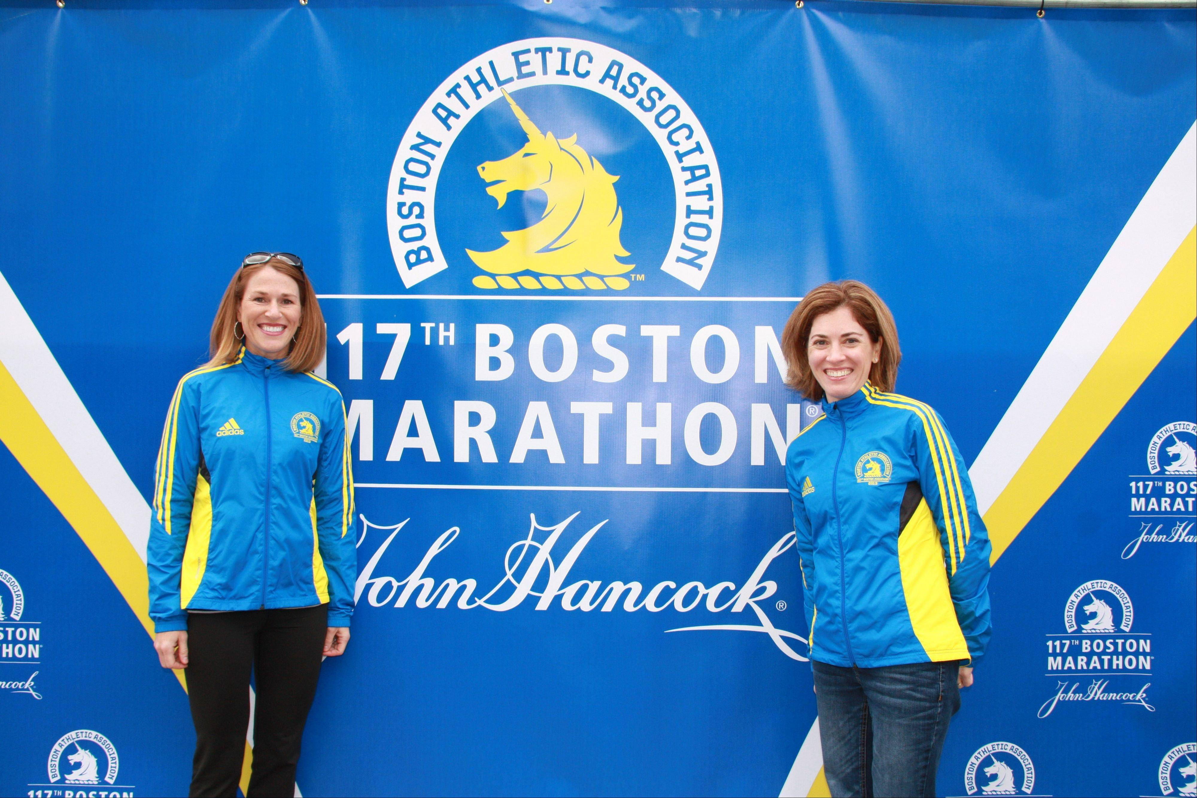 "Christine Kickels, left, of Lemont poses with her sister, Amy Bugala, 41, of Honolulu before running the Boston Marathon in April. Even though she was a block away when the bombs exploded in Boston, Kickels said she ""never had any doubt"" she'd run the Chicago Marathon on Sunday."