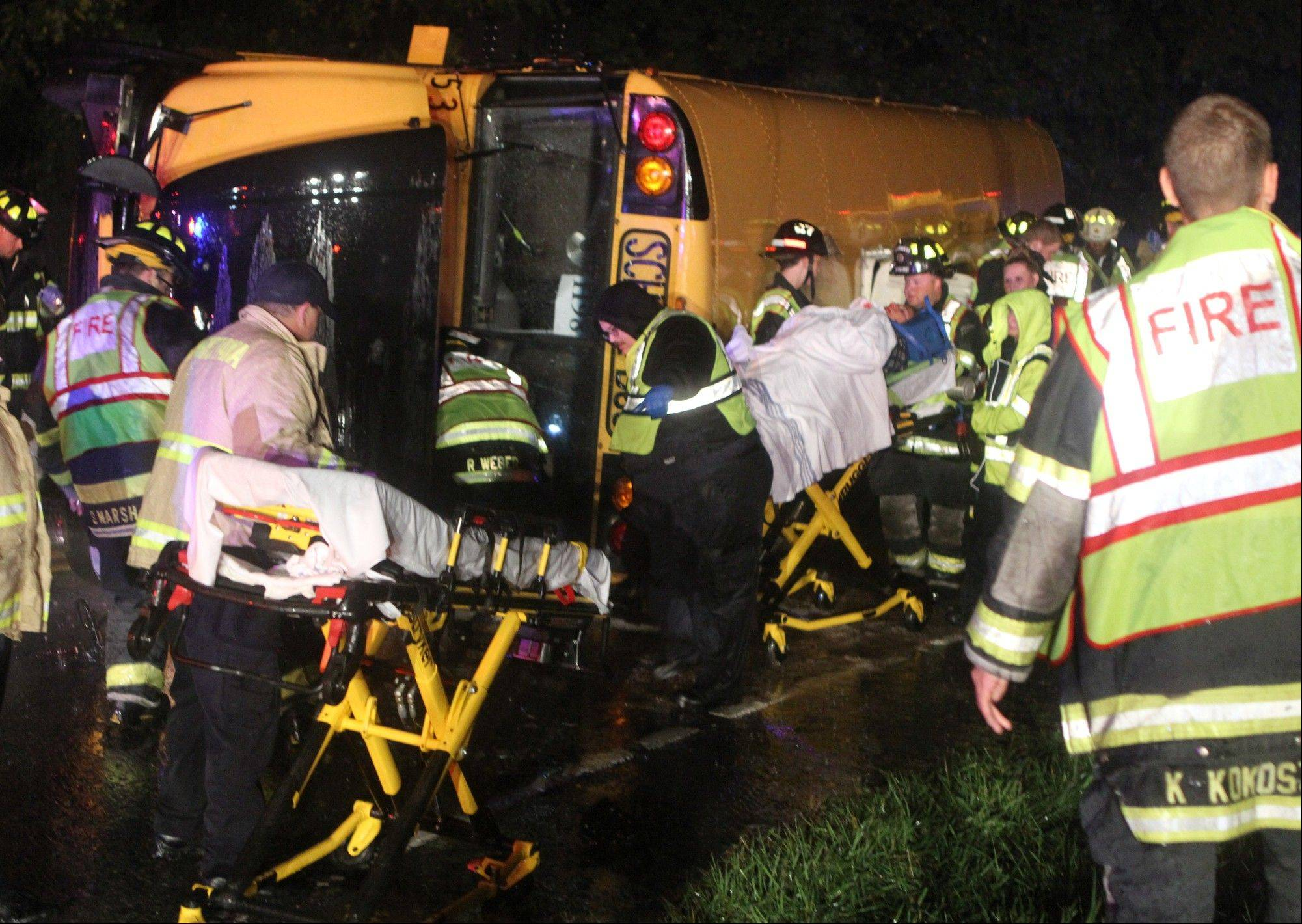 A victim is wheeled to an ambulance after a bus overturned after colliding with a carcarrier truck. Several sorority sisters from the University of Delaware were injured when a bus taking about 40 people to a party during homecoming week overturned in a crash with a tractor trailer, authorities said.