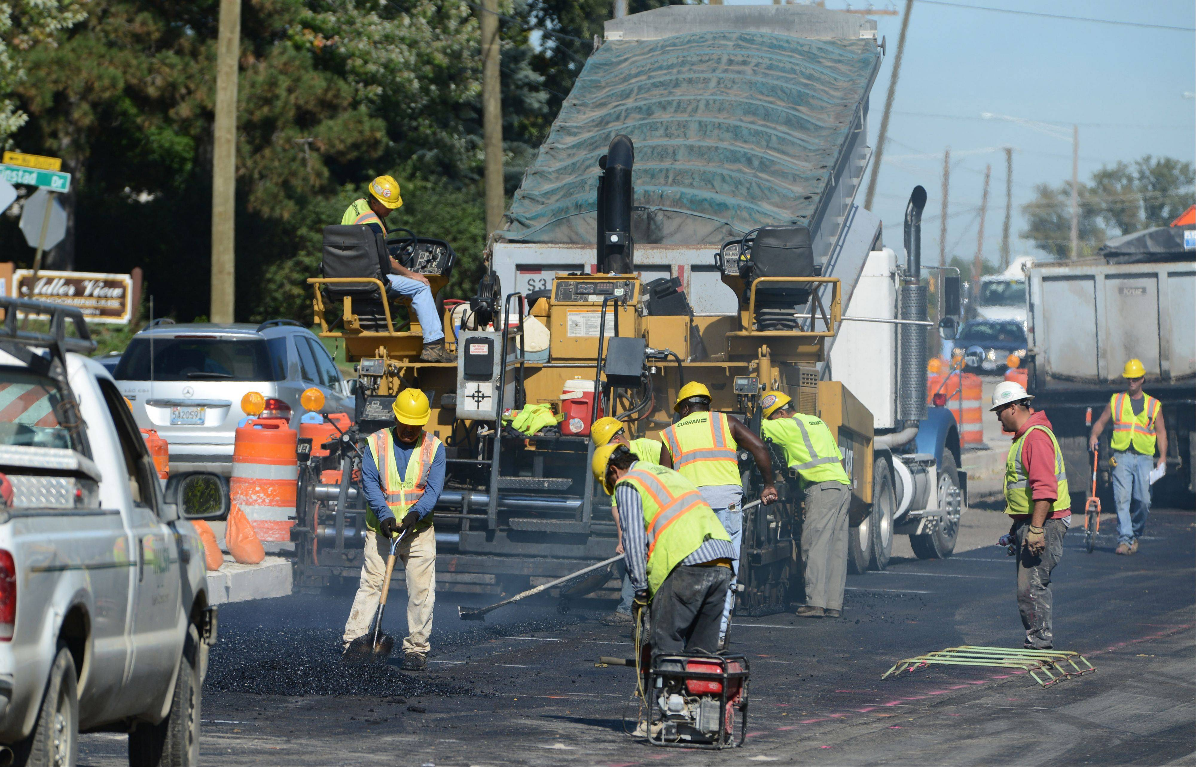 Crews pave a section of Milwaukee Avenue in Libertyville just south of Peterson Road (Route 137).