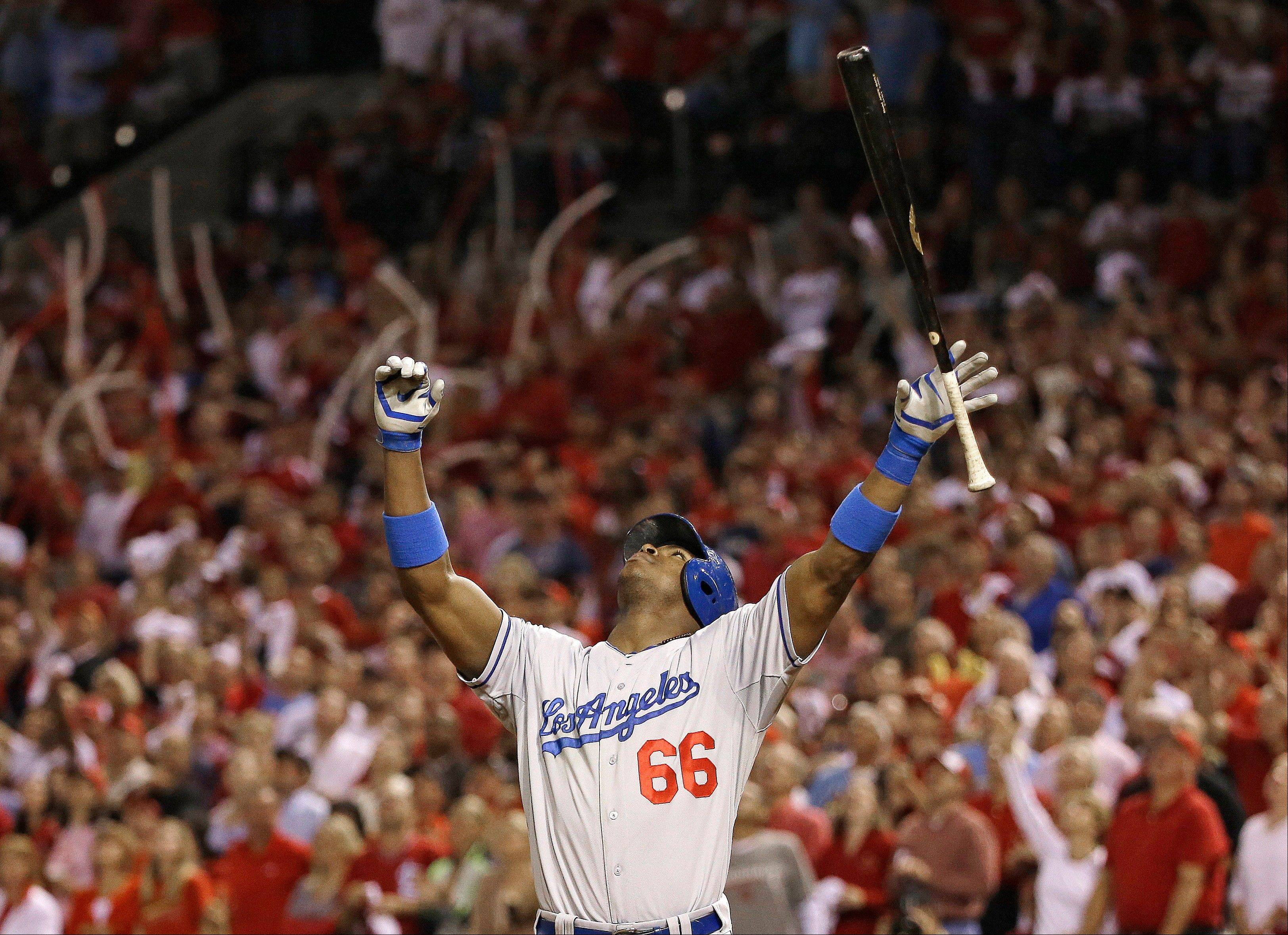 The Dodgers' Yasiel Puig looks up as he pops out during the fifth inning of Game 1.