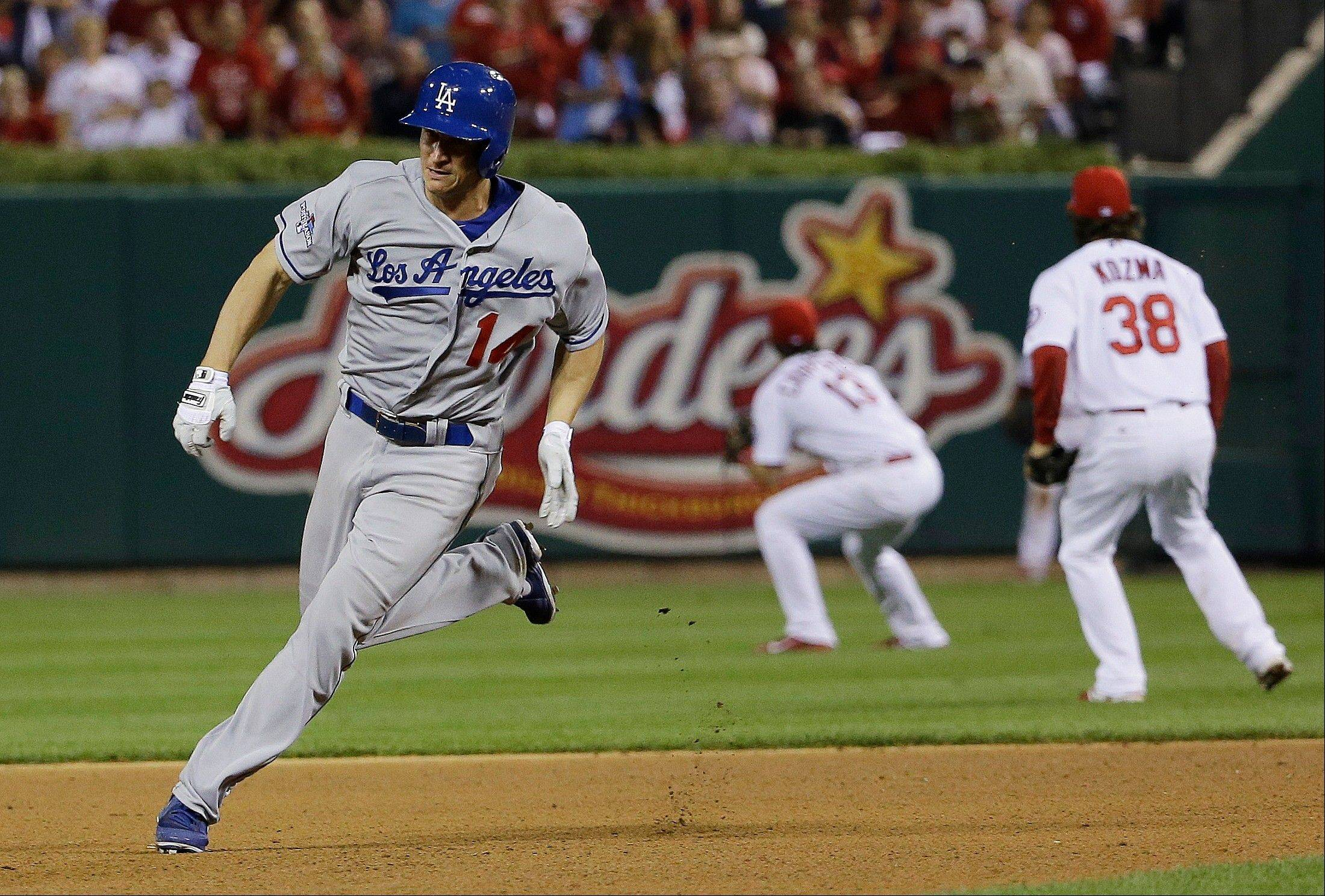 The Dodgers' Mark Ellis races to third for a triple during the 10th inning.