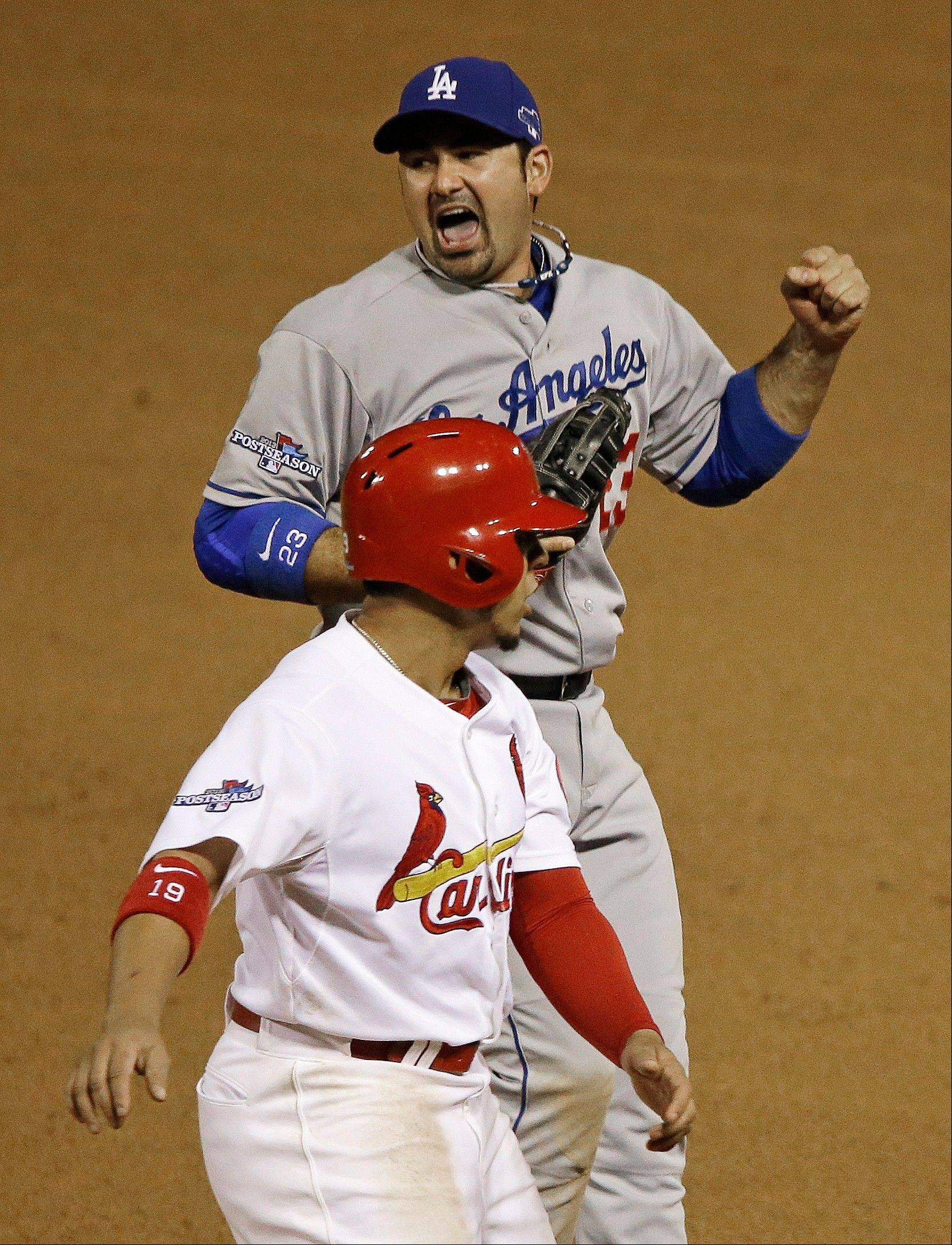 Dodgers first baseman Adrian Gonzalez reacts to doubling off the Cardinals' Jon Jay at first during the seventh inning Friday in St. Louis.