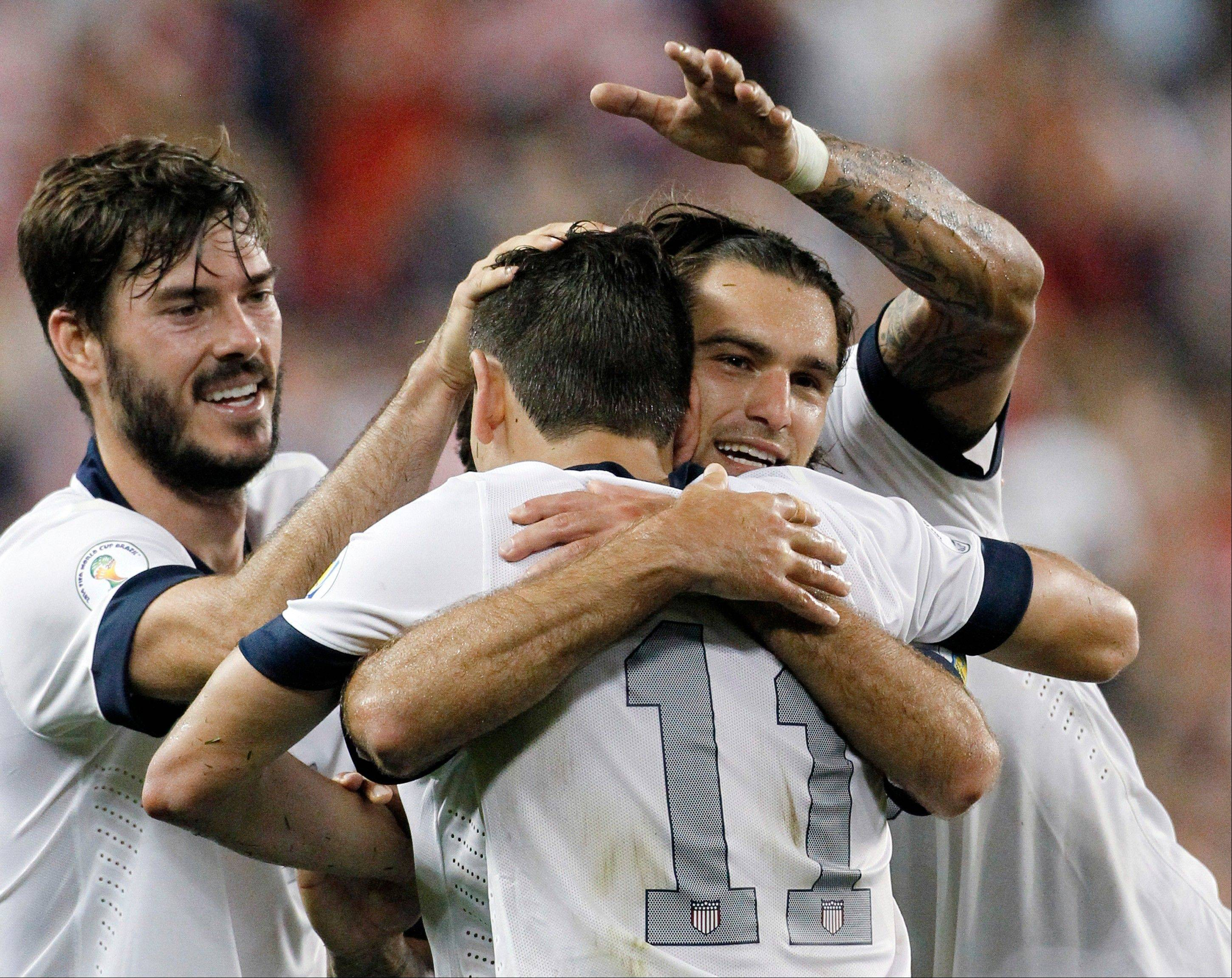 U.S. defender Brad Evans, left, midfielder Graham Zusi, center, facing camera, and midfielder Alejandro Bedoya celebrate Zusi's goal in the second half of a World Cup qualifier against Jamaica on Friday at Sporting Park in Kansas City, Kan.