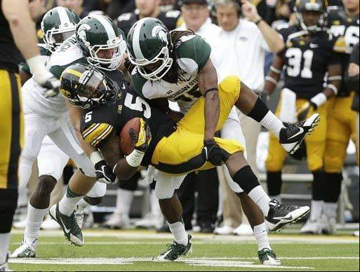 Michigan State's Max Bullough, left, and Trae Waynes tackle Iowa running back Damon Bullock during the first half of 26-14 win last Saturday in Iowa City, Iowa.