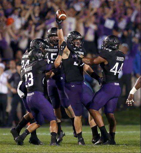 Northwestern defensive lineman Tyler Scott celebrates after causing a fumble by Ohio State quarterback Braxton Miller during last week's game in Evanston.