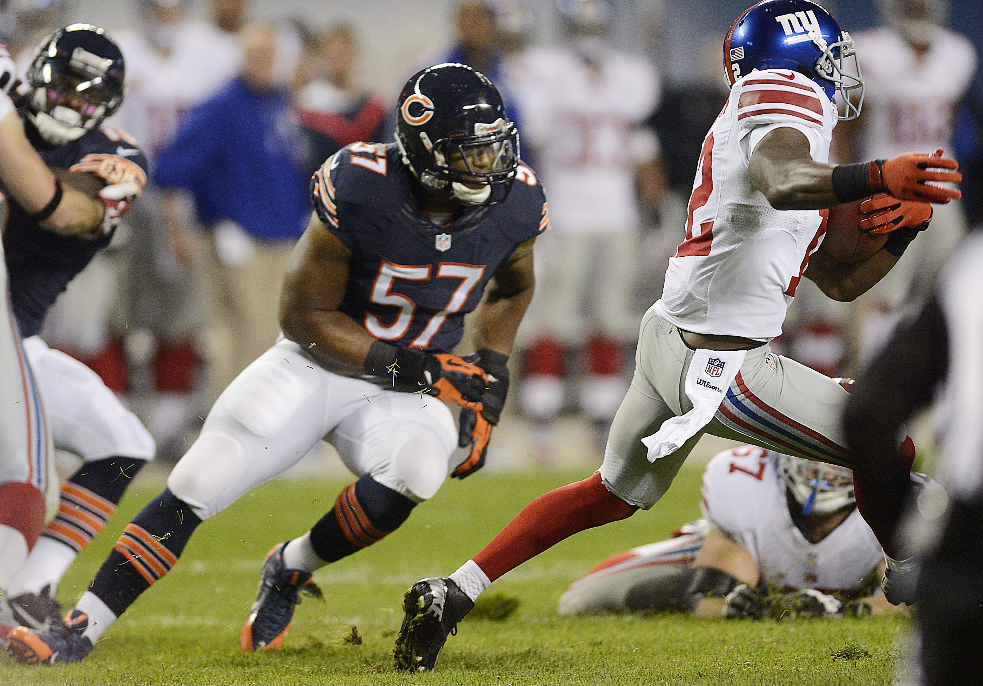 Bears rookie linebacker Jon Bostic chases New York Giants wide receiver Jerrel Jernigan Thursday night at Soldier Field in Chicago. Bostic had 1 tackle in the game.